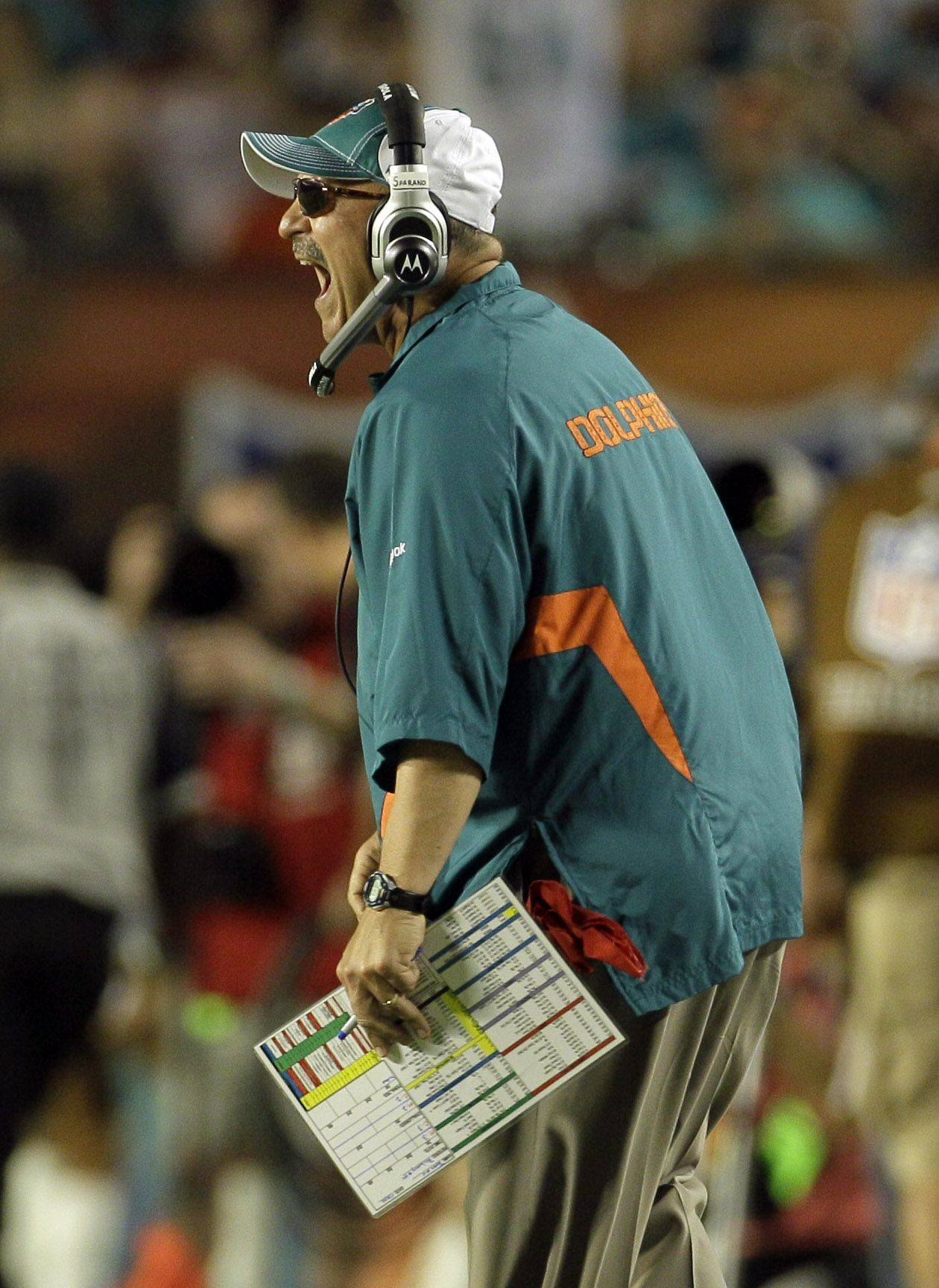 Miami Dolphins head coach Tony Sparano yells from the sidelines during an NFL football game against the Chicago Bears.
