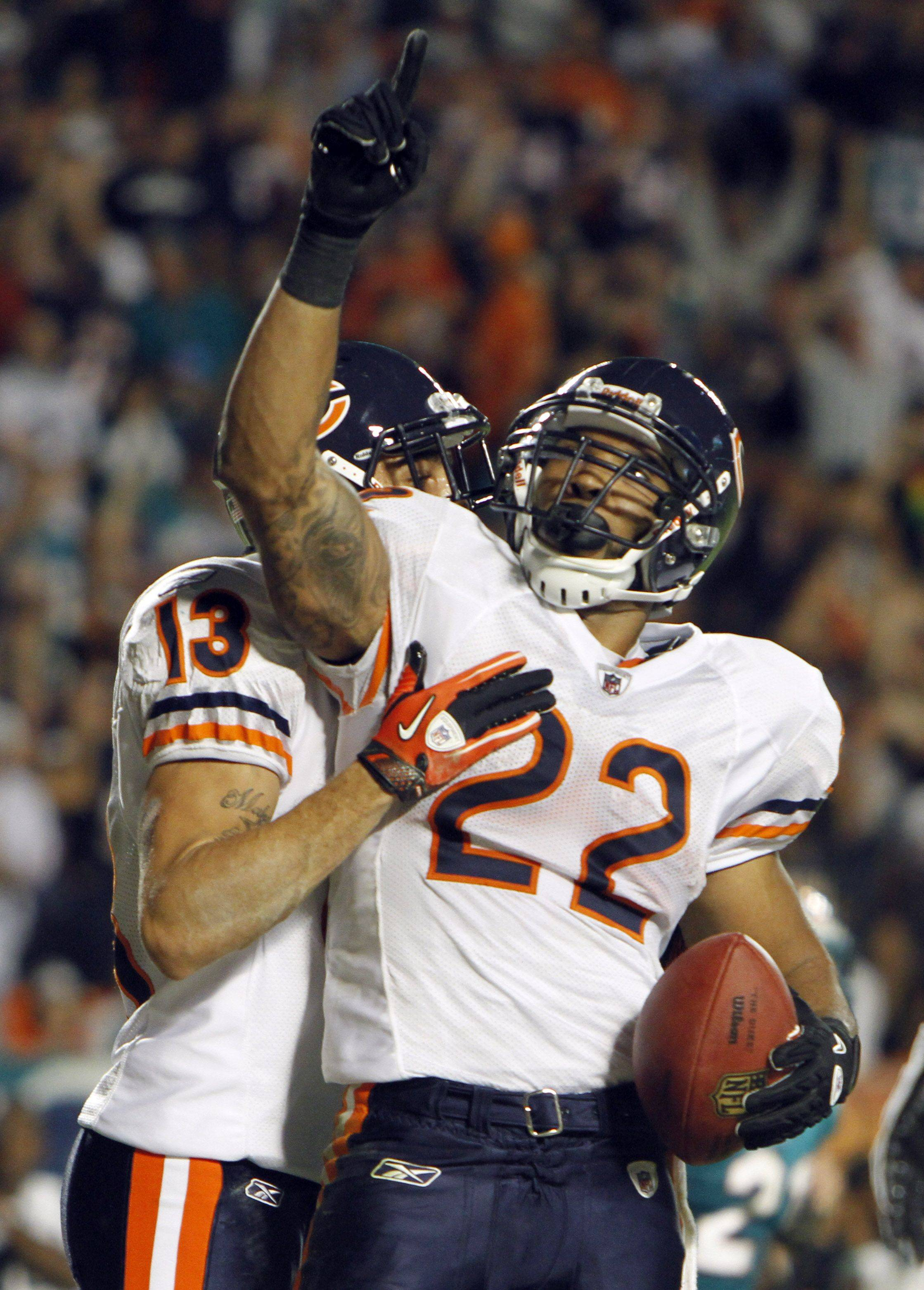 Chicago Bears running back Matt Forte reacts after scoring a touchdown during the third quarter. Bears wide receiver Johnny Knox also reacts.