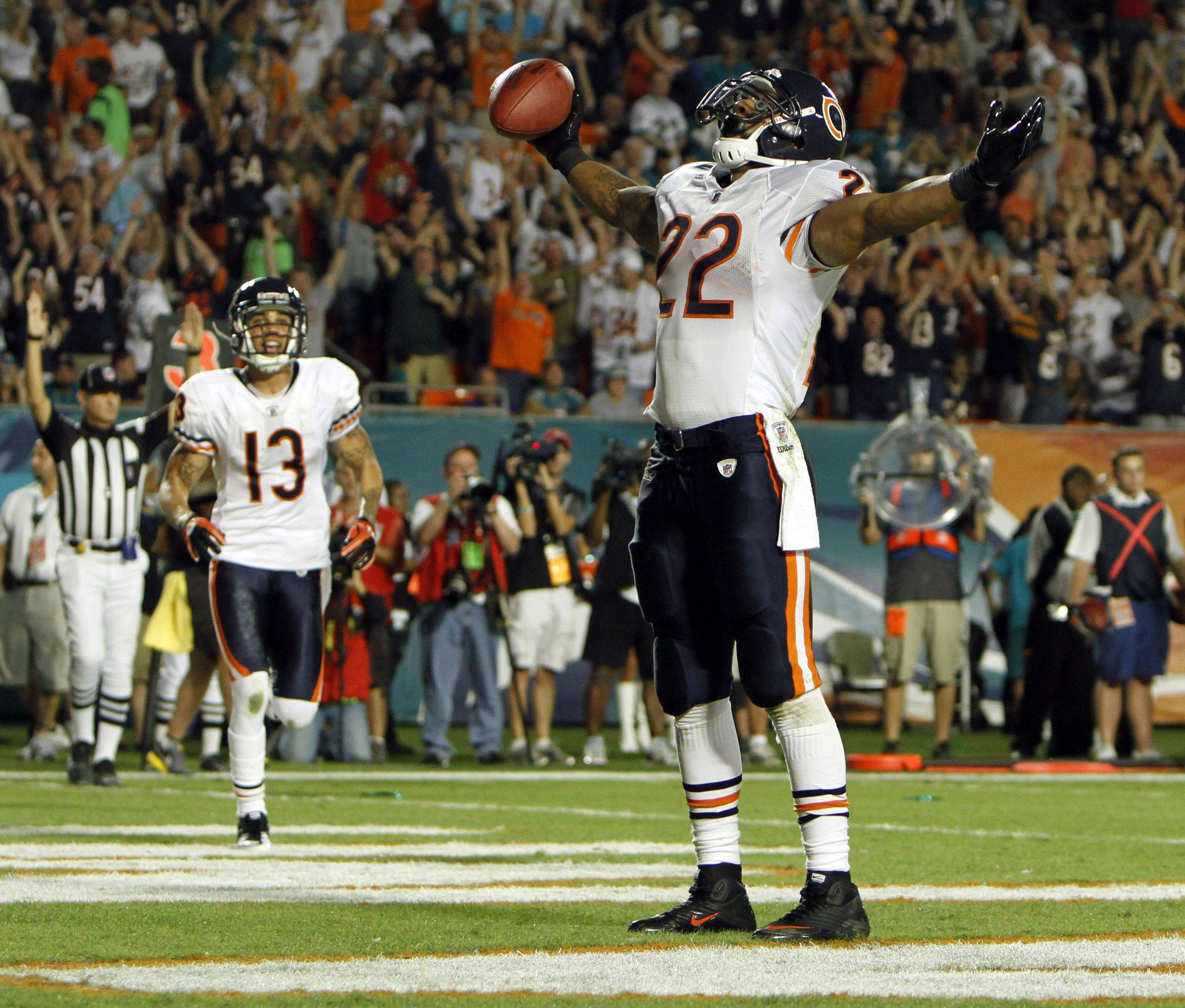 Chicago Bears running back Matt Forte reacts after scoring a touchdown during the third quarter .