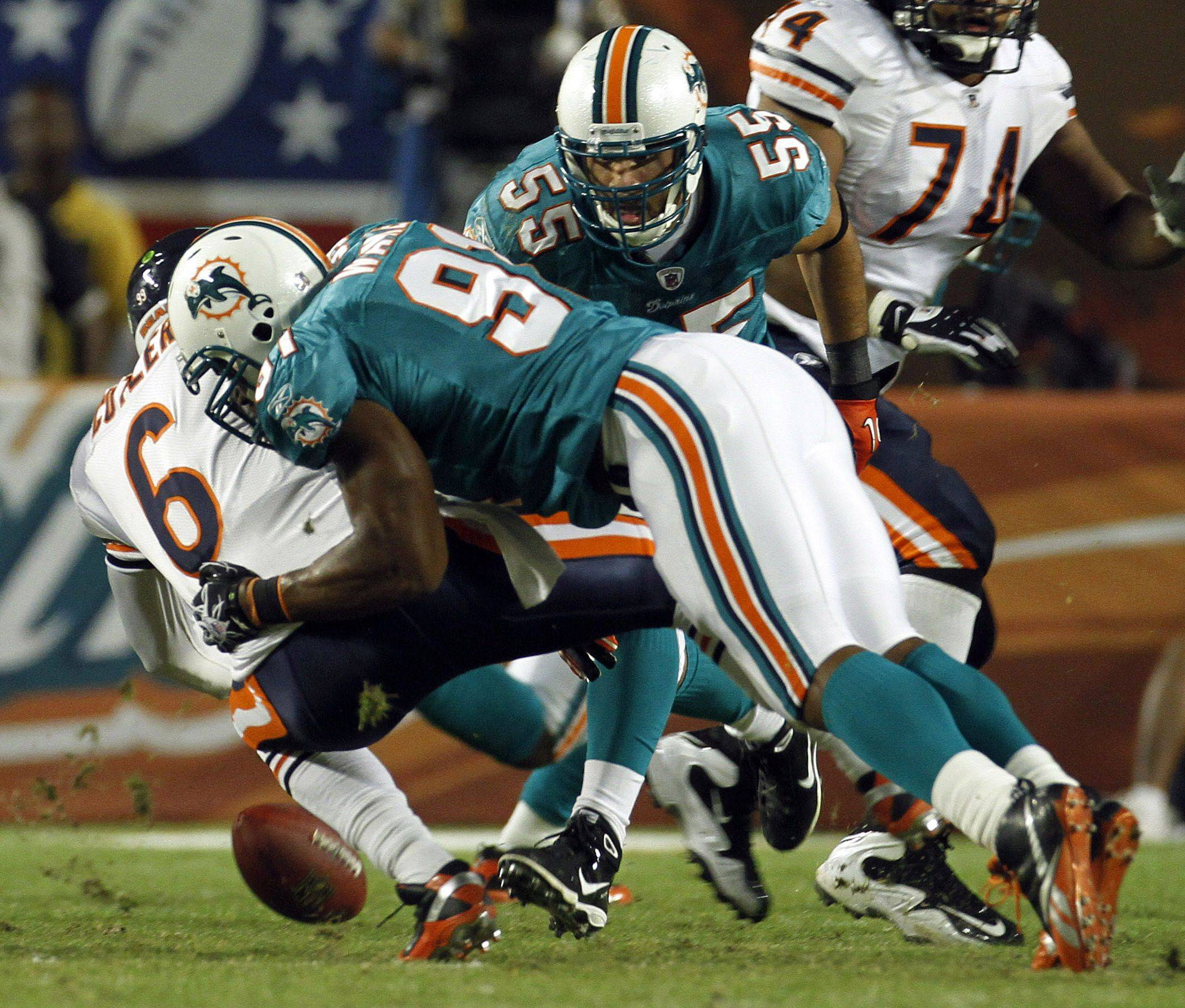 Miami Dolphins linebacker Cameron Wake sacks Chicago Bears quarterback Jay Cutler during the first quarter .