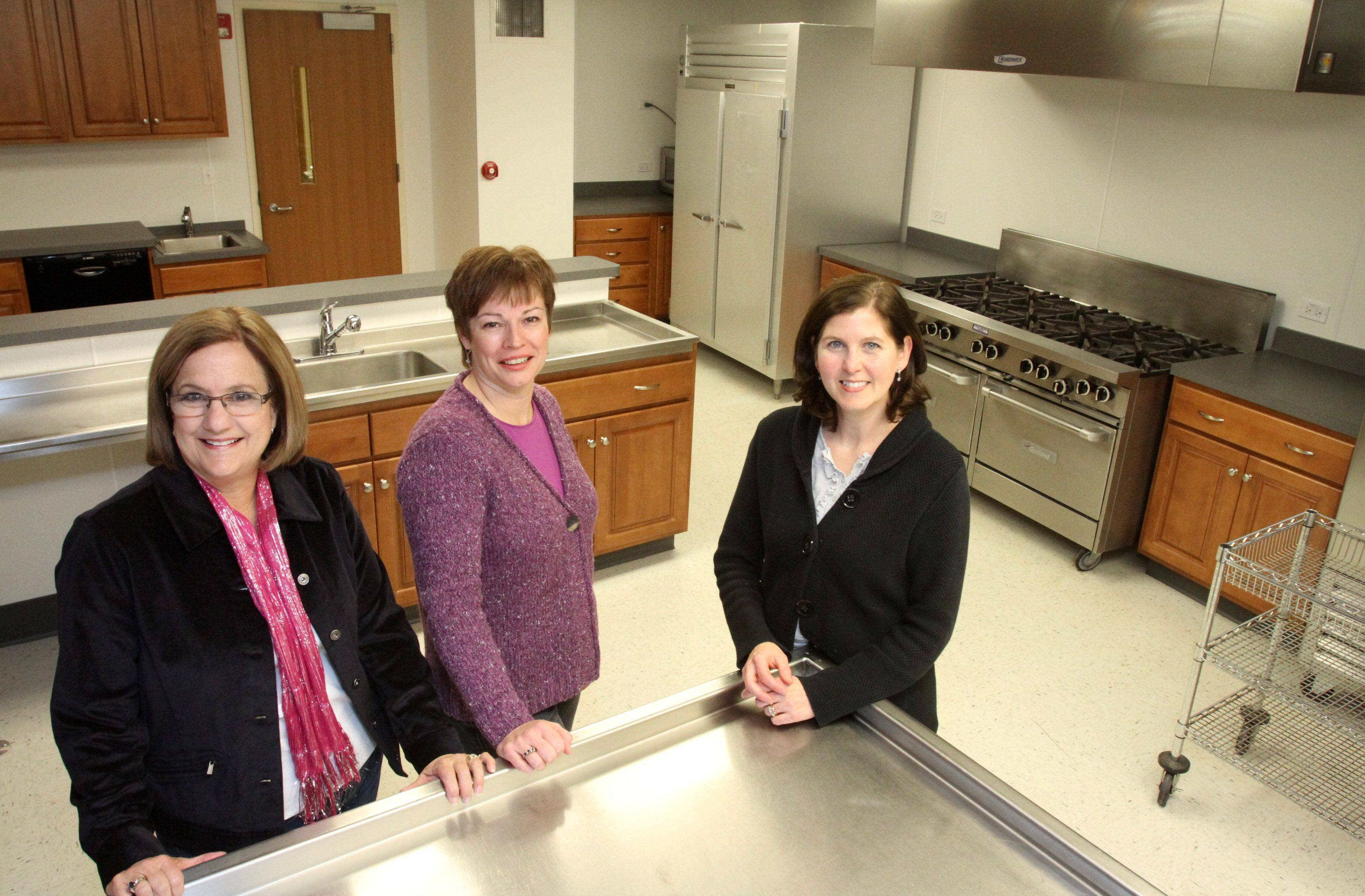 Betsy Swank, owner of Designs in Context, from left, Julia Karnstedt, design assistant, and Mary Ann Seagrist with Brighton Cabinetry used their skills and connections to help build a new kitchen for St. Lawrence Episcopal Church in Libertyville.
