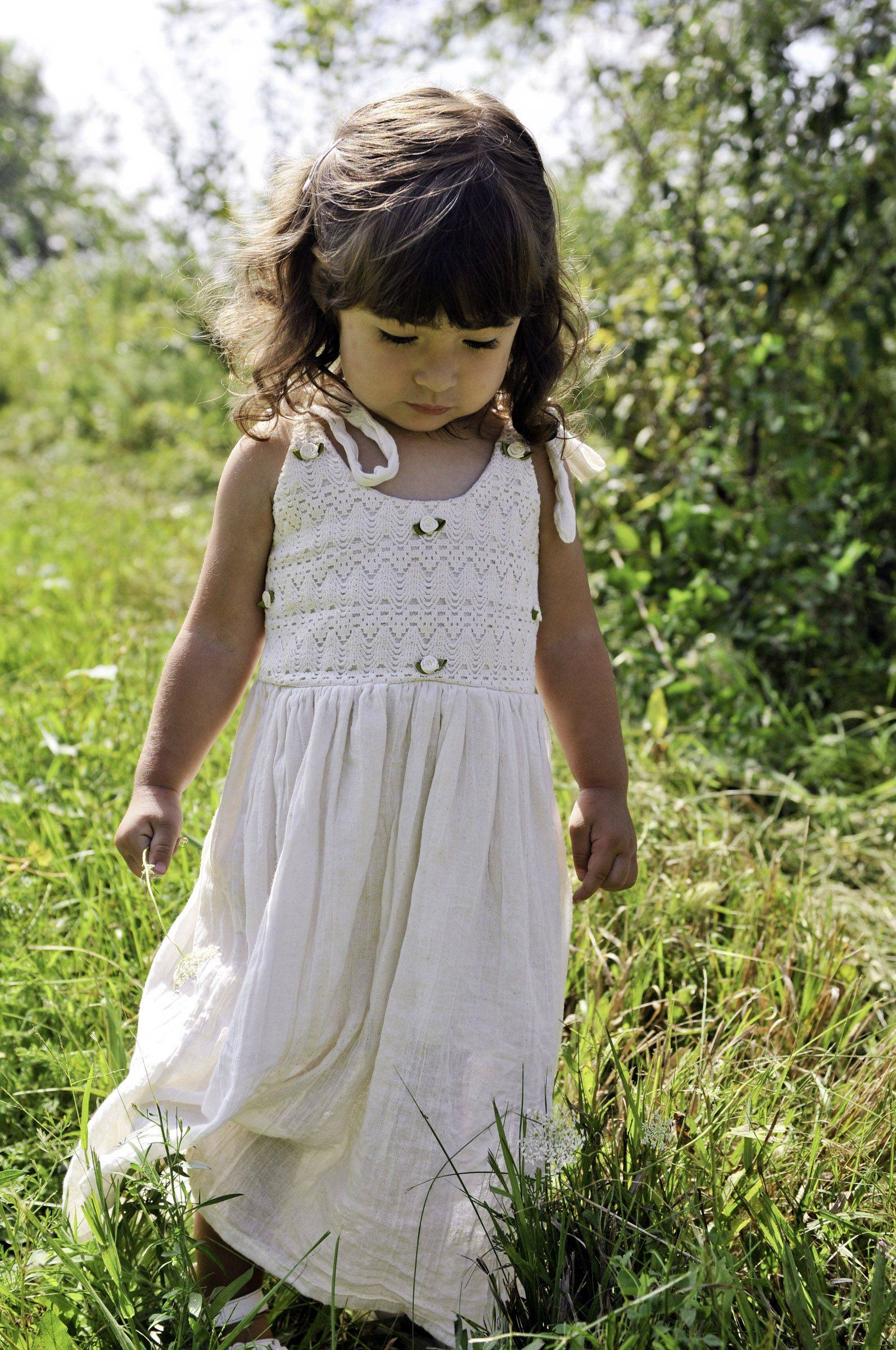 Gia Pasquale, 2, looks down to her feet at the Hampshire Forest Preserve on Allen Road.