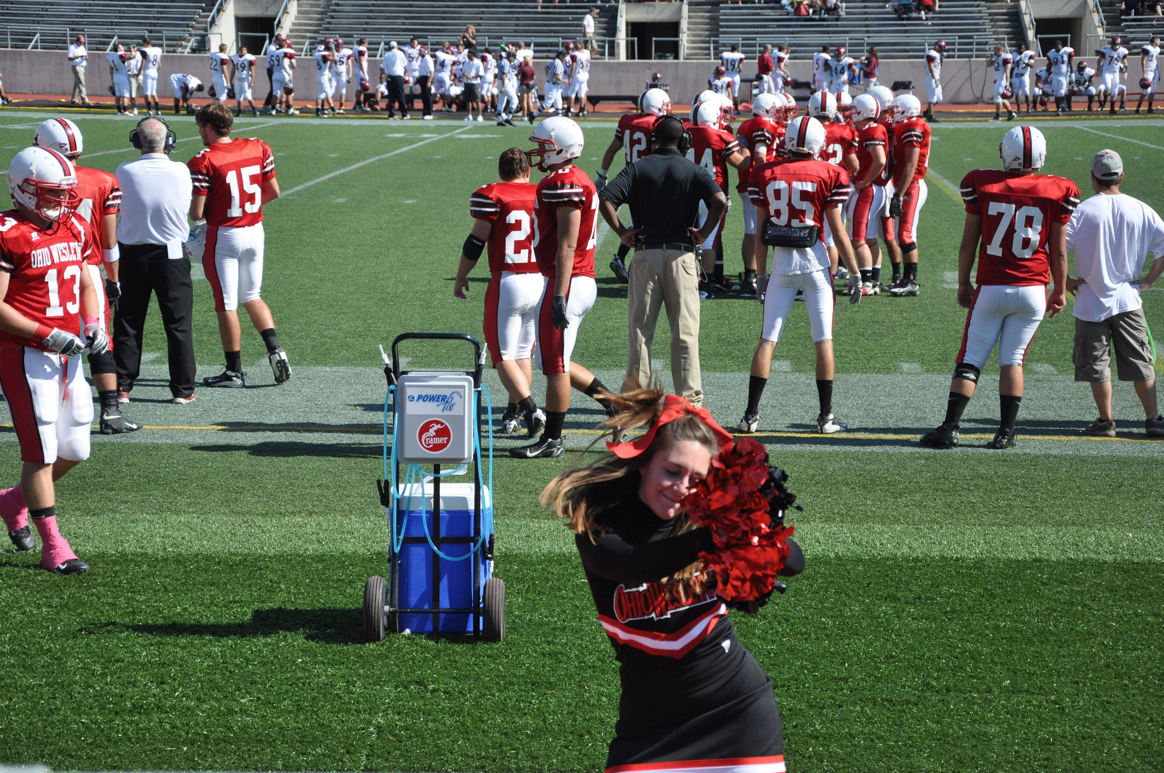 Cheerleader Emily LeTourneau fires up the crowd at the Ohio Wesleyan University Homecoming football game on October 9, 2010.