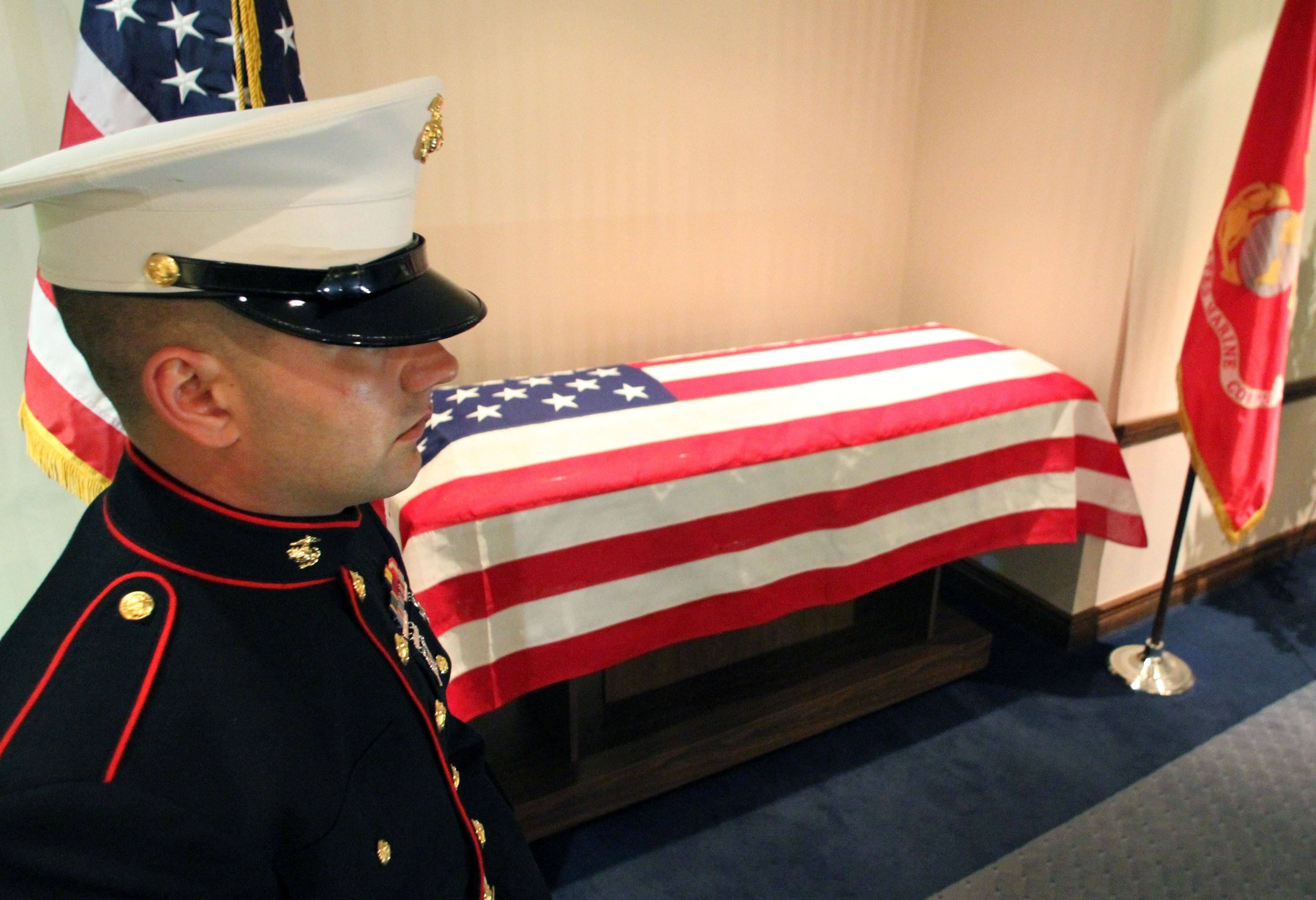Marine honor guard Cpl. Adam Hermanowicz guards the casket of Lance Cpl. James Stack, 20, of Arlington Heights.