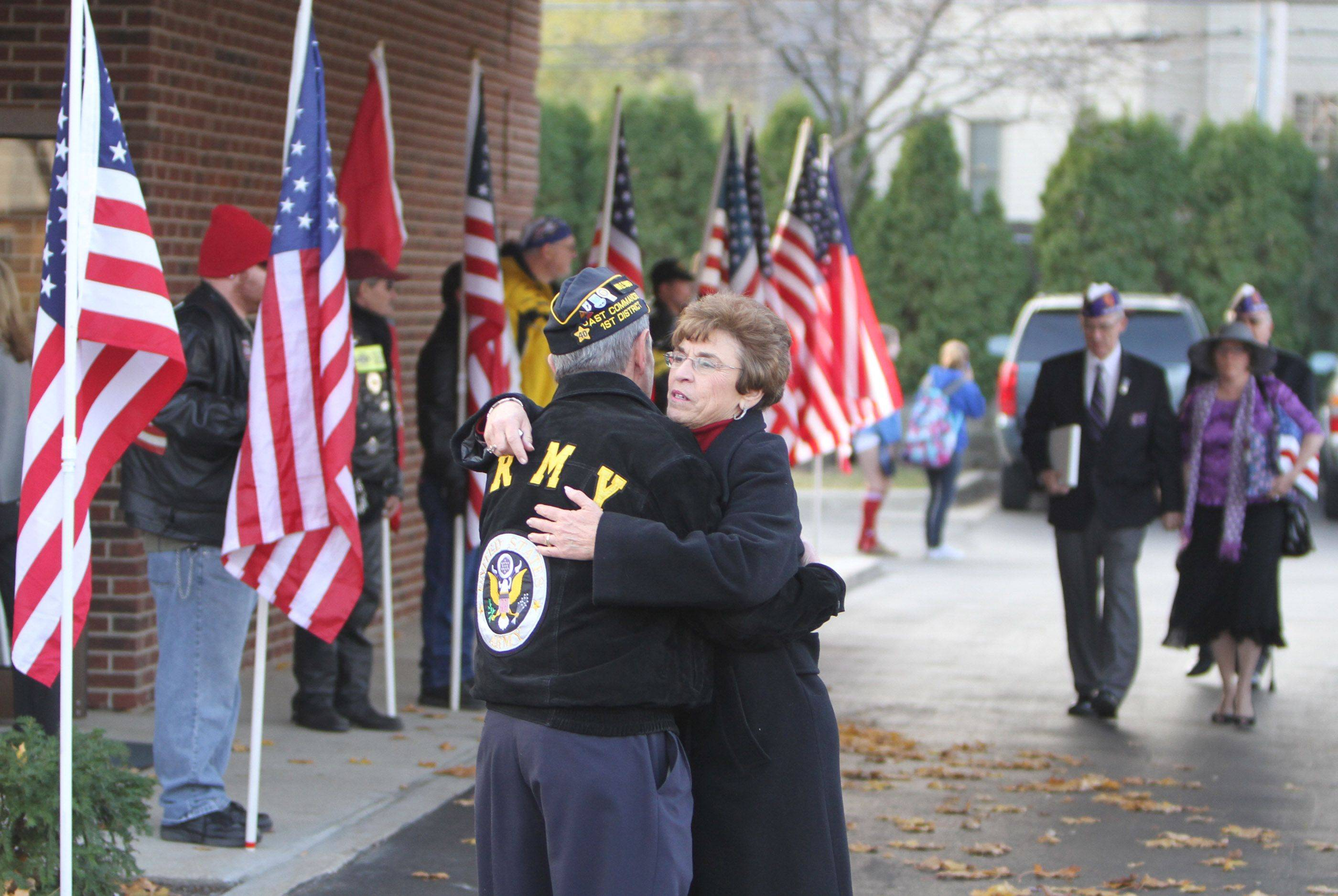 Bob Ferraro with American Legion Post 134 gives Arlington Heights Mayor Arlene Mulder a hug as she arrives at the visitation for Lance Cpl. James Stack.