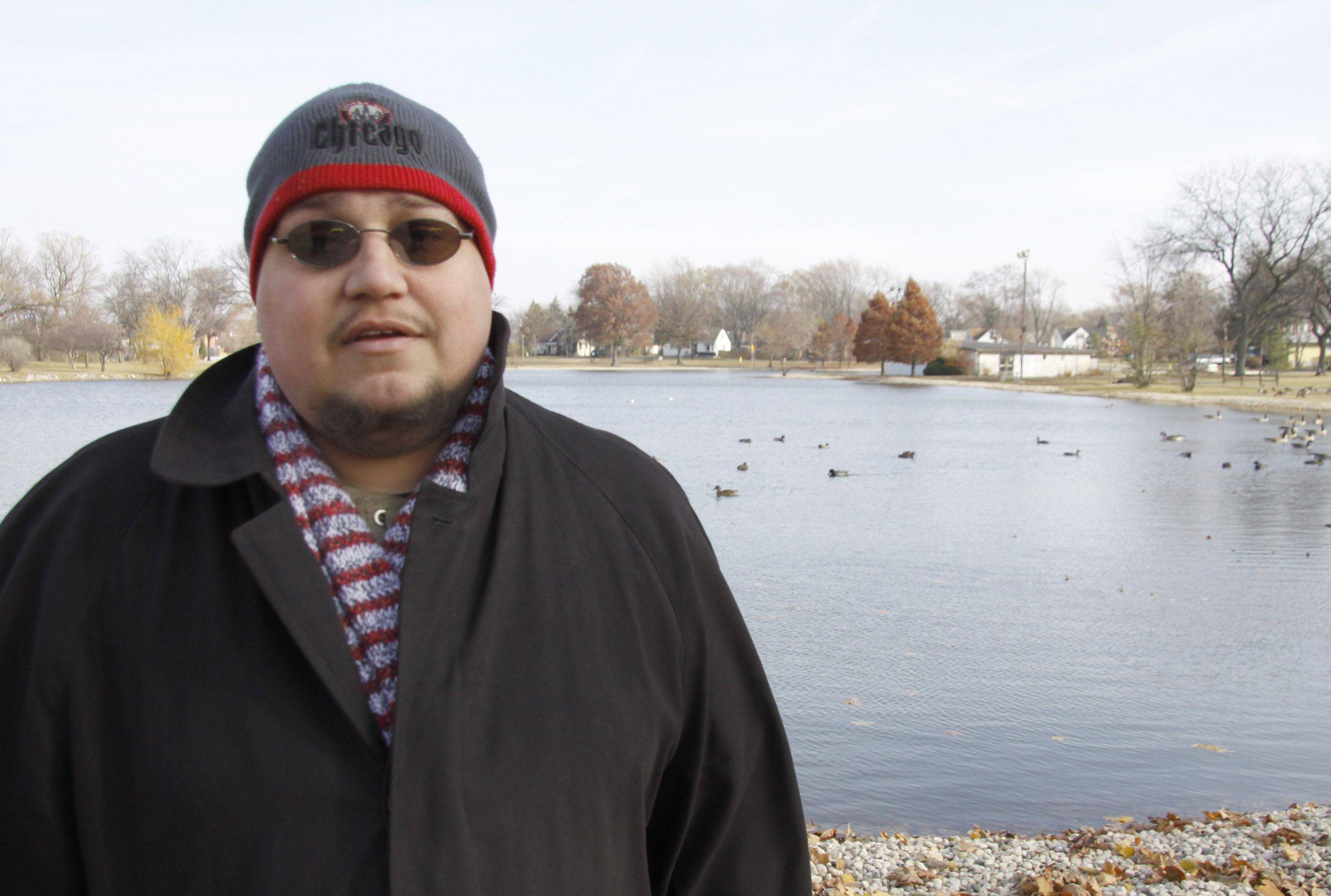 "Dom De Bellis stands at the shore of Lombard Lagoon, where he recently found some rocks he fears may be coated with an oily substance.  ""I moved out here with my family when I was 7 and my first memory is of this lagoon,"" De Bellis said."