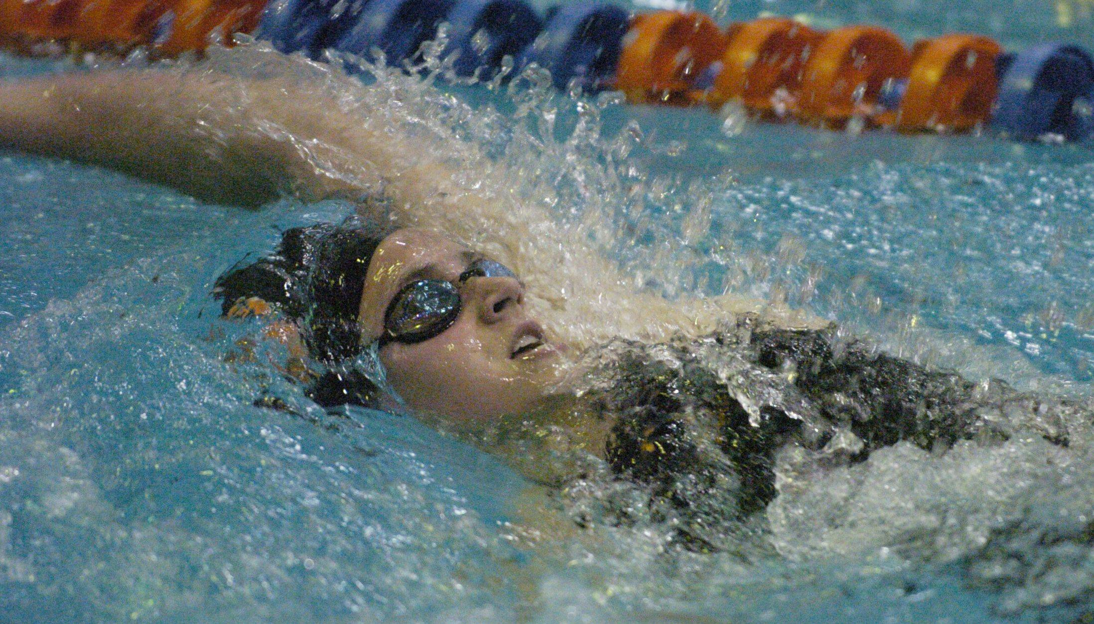 Whitney Mitchell of St. Charles East swims the 200-yard individual medley during Friday's girls state swimming prelims at Evanston High School.