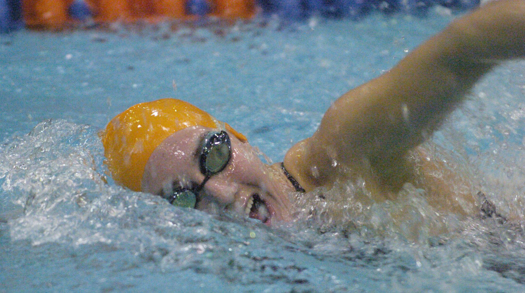 Emma Smith of St. Charles East swims the 500-yard freestyle during Friday's girls state swimming prelims at Evanston High School.