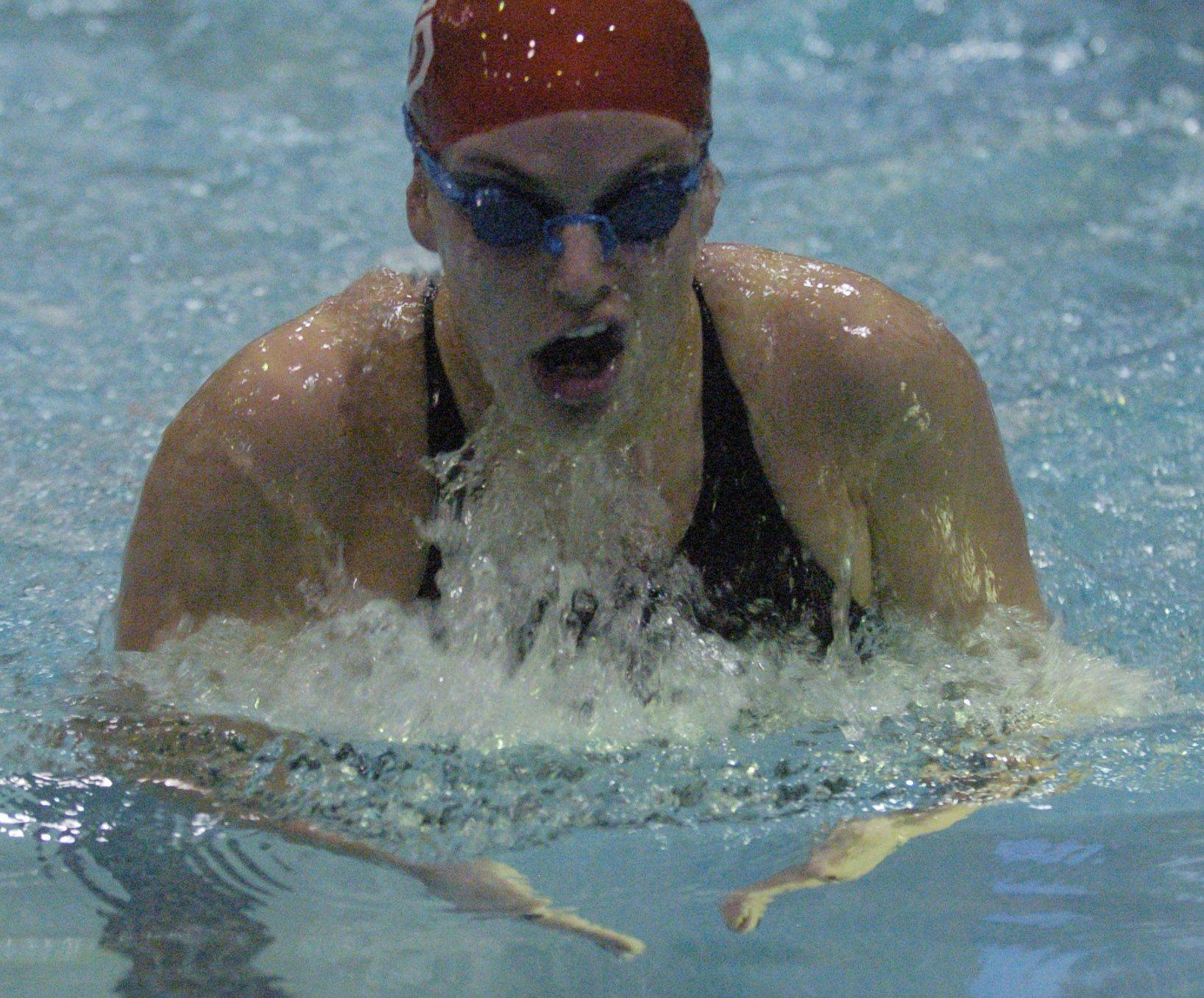Colleen Champa of Dundee Crown swims the 100-yard breast stroke during Friday's girls state swimming prelims at Evanston High School.