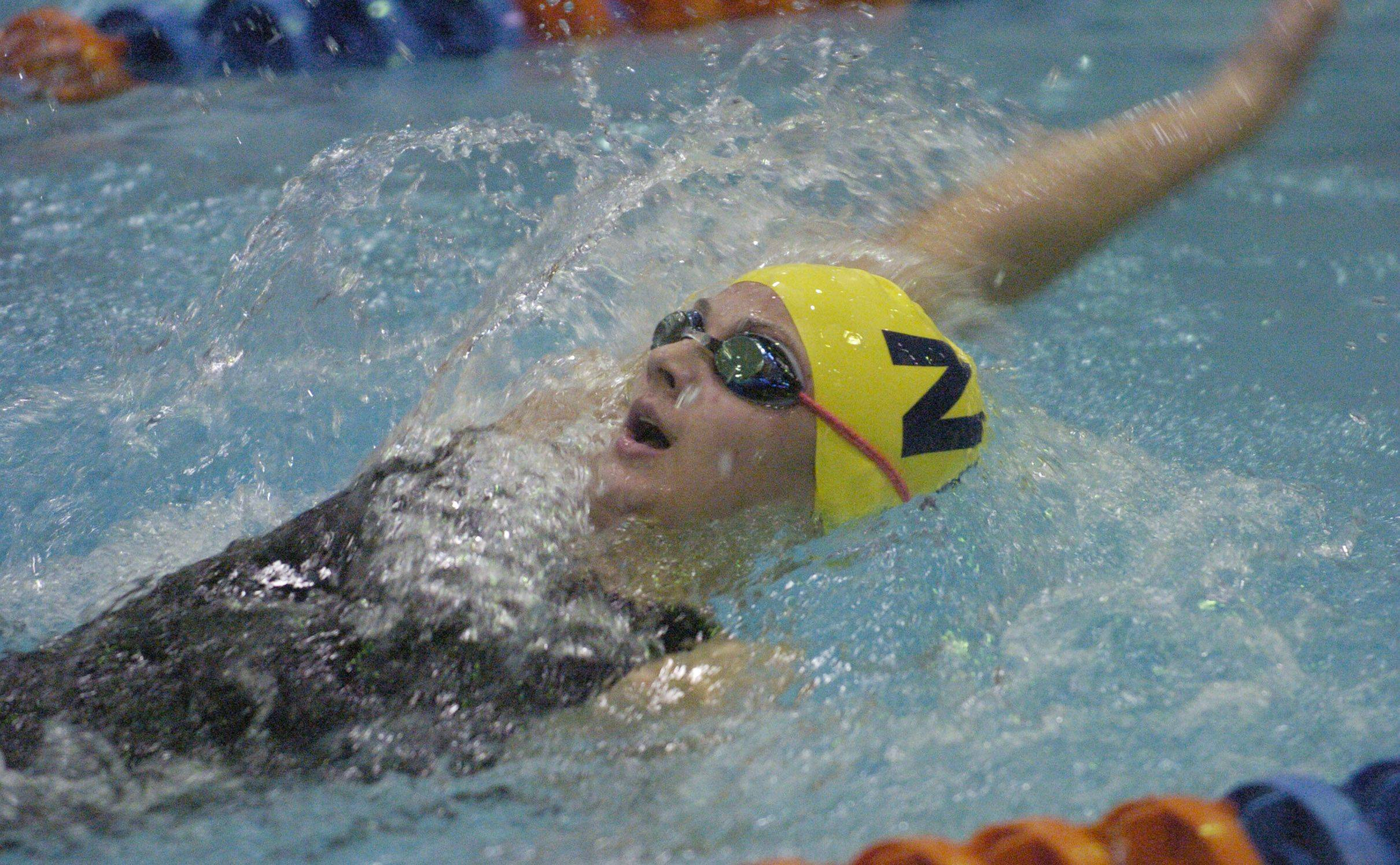 Gia Delasandro of Neuqua Valley swims the 100-yard backstroke during Friday's girls state swimming prelims at Evanston High School.