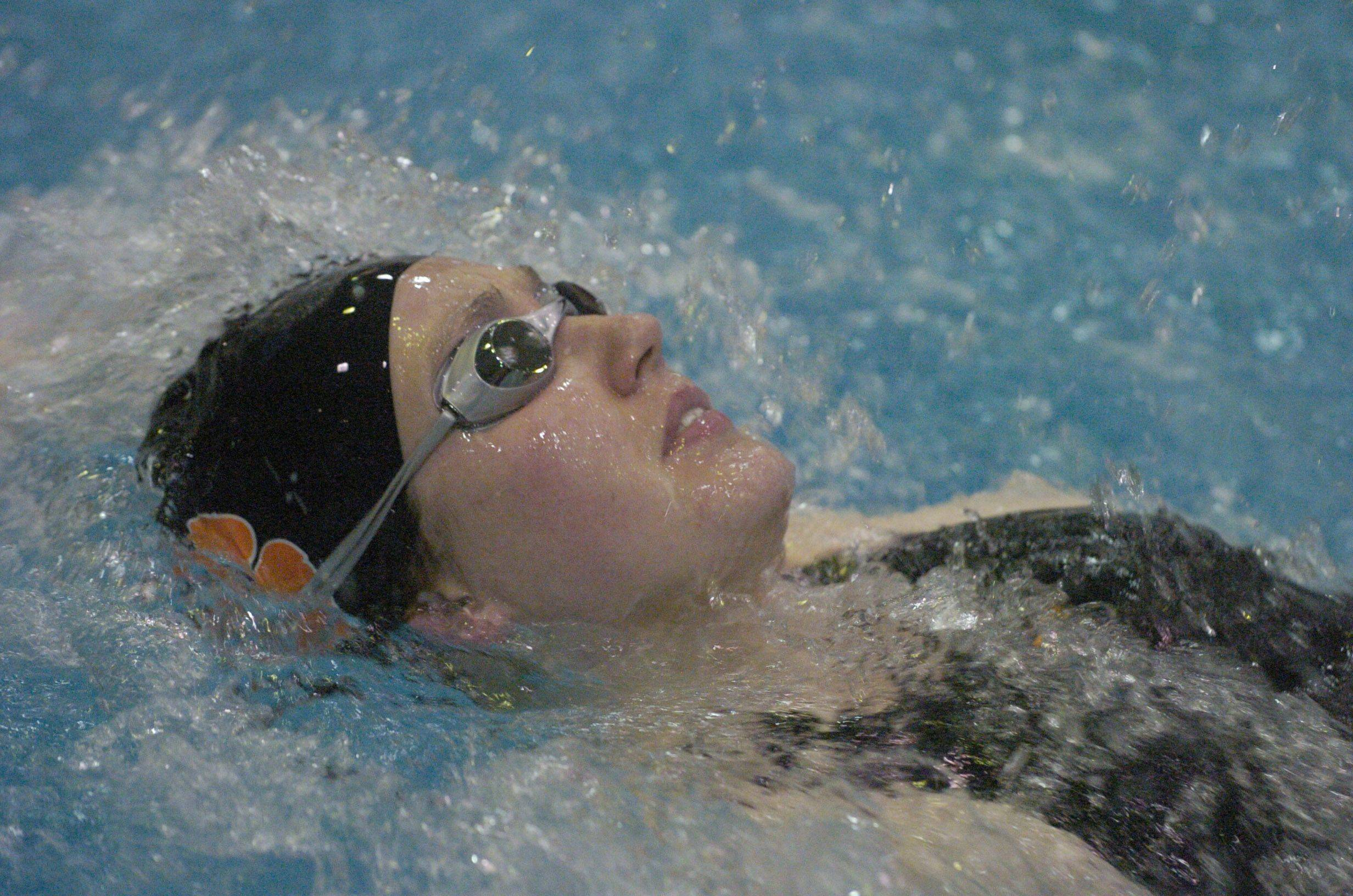 Kaitlin Amedio of Libertyville swims backstroke during the 200-yard medley relay during Friday's girls state swimming prelims at Evanston High School.