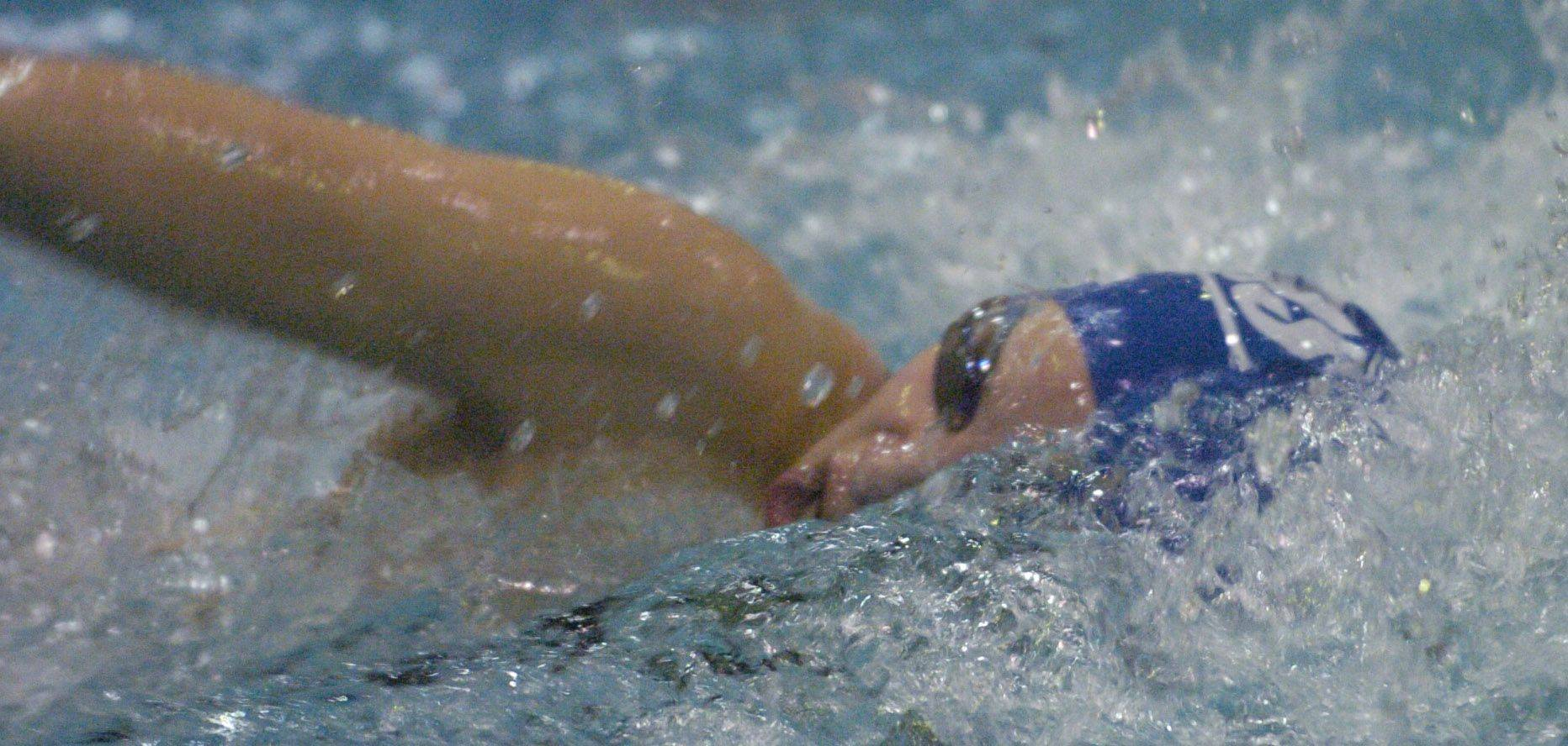 Zoe Eldridge of Vernon Hills swims the 100-yard freestyle during Friday's girls state swimming prelims at Evanston High School.