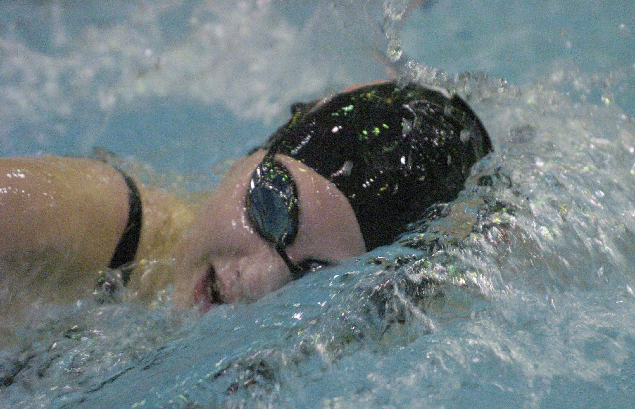 Libertyville's Morgan Dickson swims the 500-yard freestyle during Friday's girls state swimming prelims at Evanston High School.
