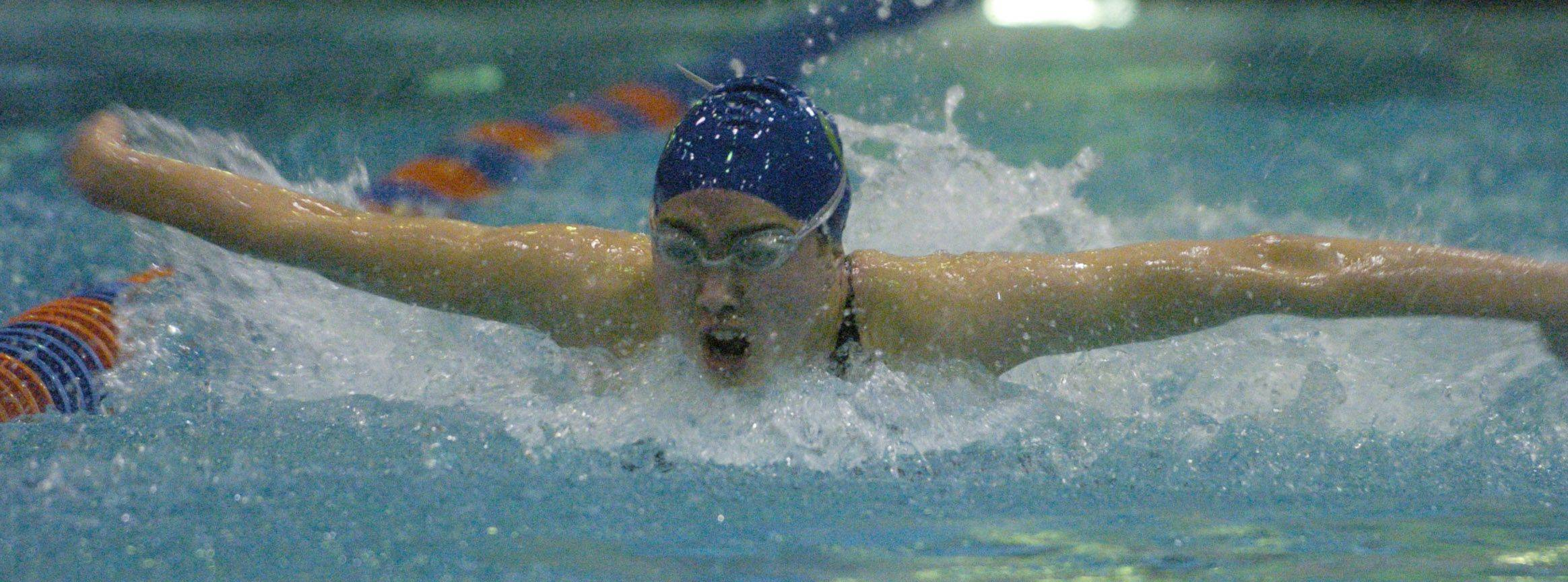 Connie Hsu of Glenbard West Coop swims the 100-yard butterfly during Friday's girls state swimming prelims at Evanston High School.