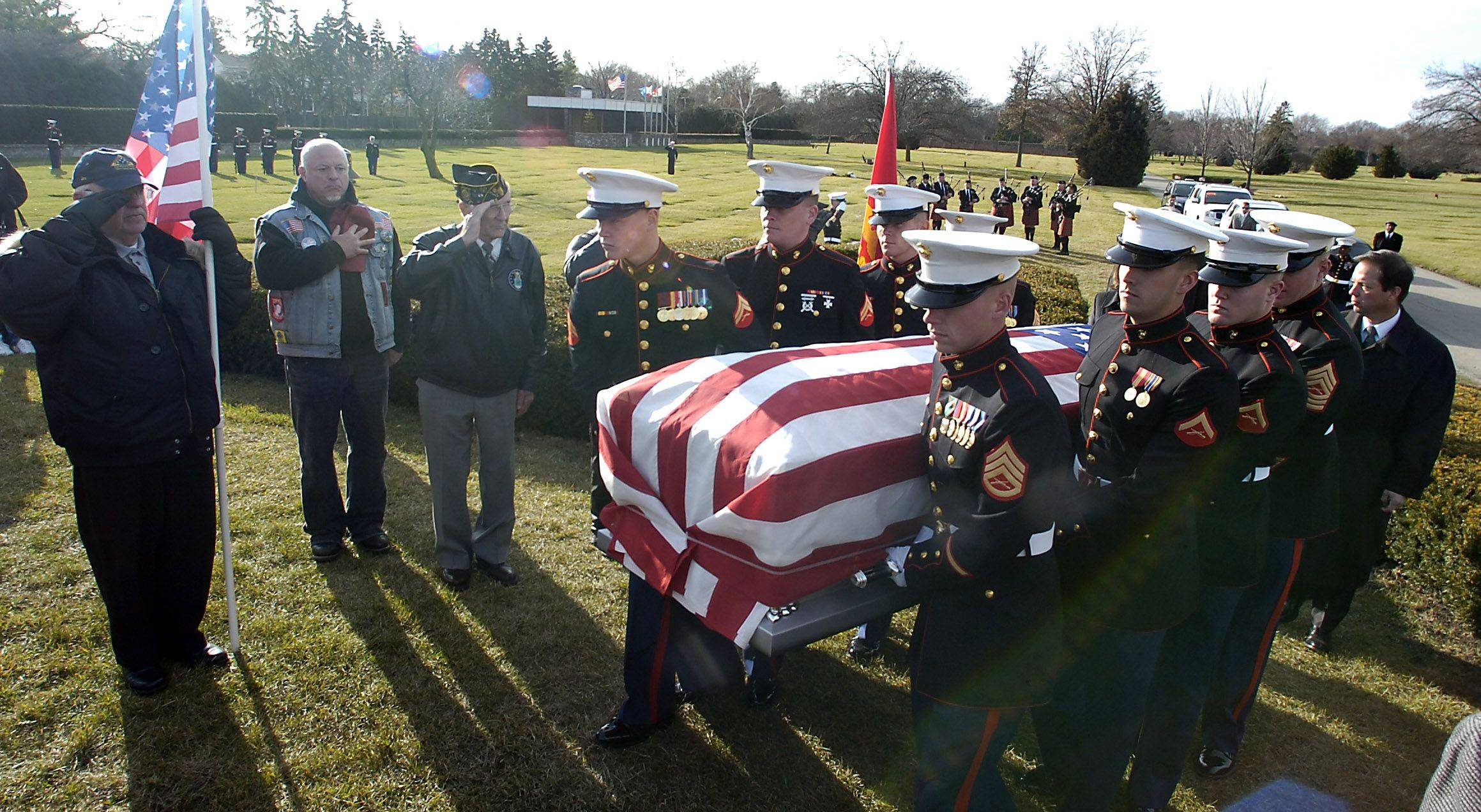 The body of Lance Corporal James Stack is carried to his final resting place in Memory Gardens in Arlington Heights on Saturday.