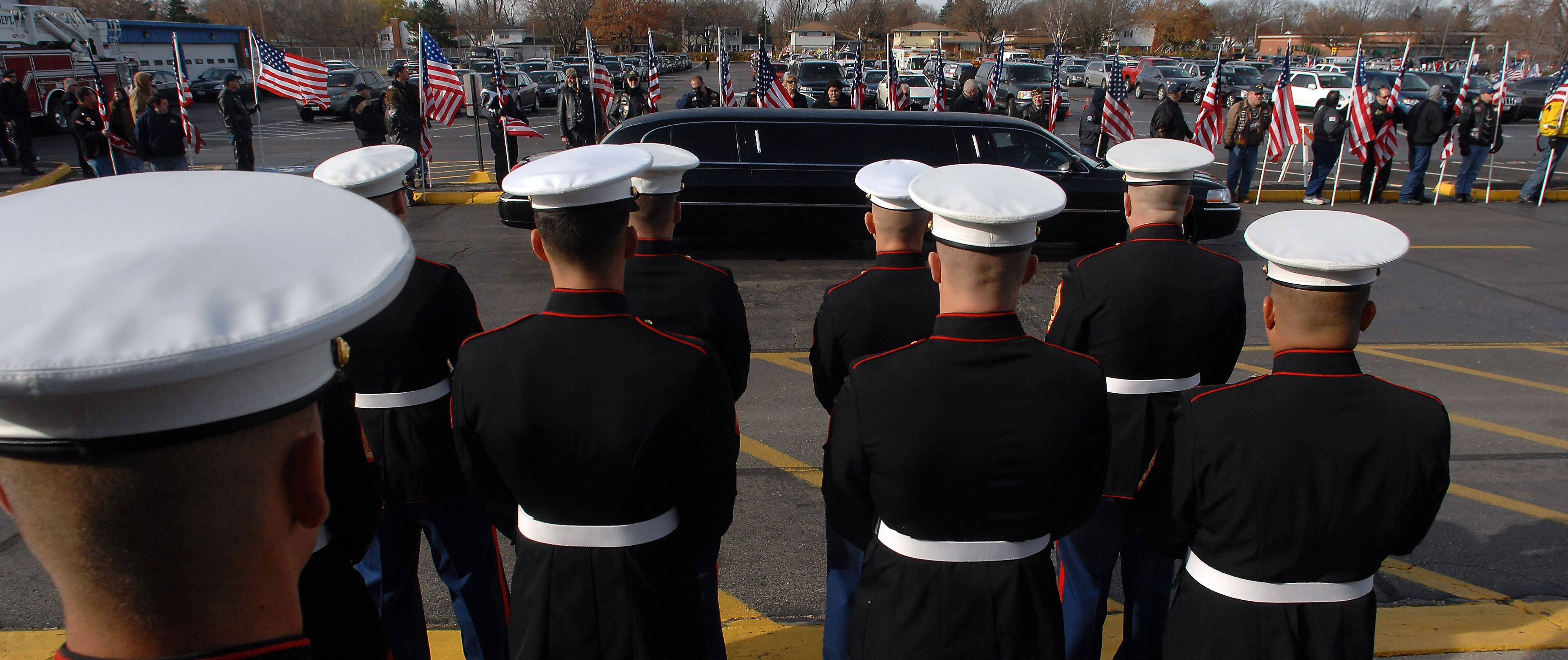 Marines prepare to accept the coffin of Lance Corporal James Stack for his memorial service at Prospect High School on Saturday.
