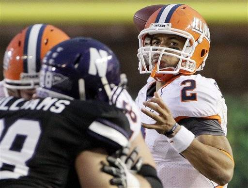 Illinois quarterback Nathan Scheelhaase looks to a pass.