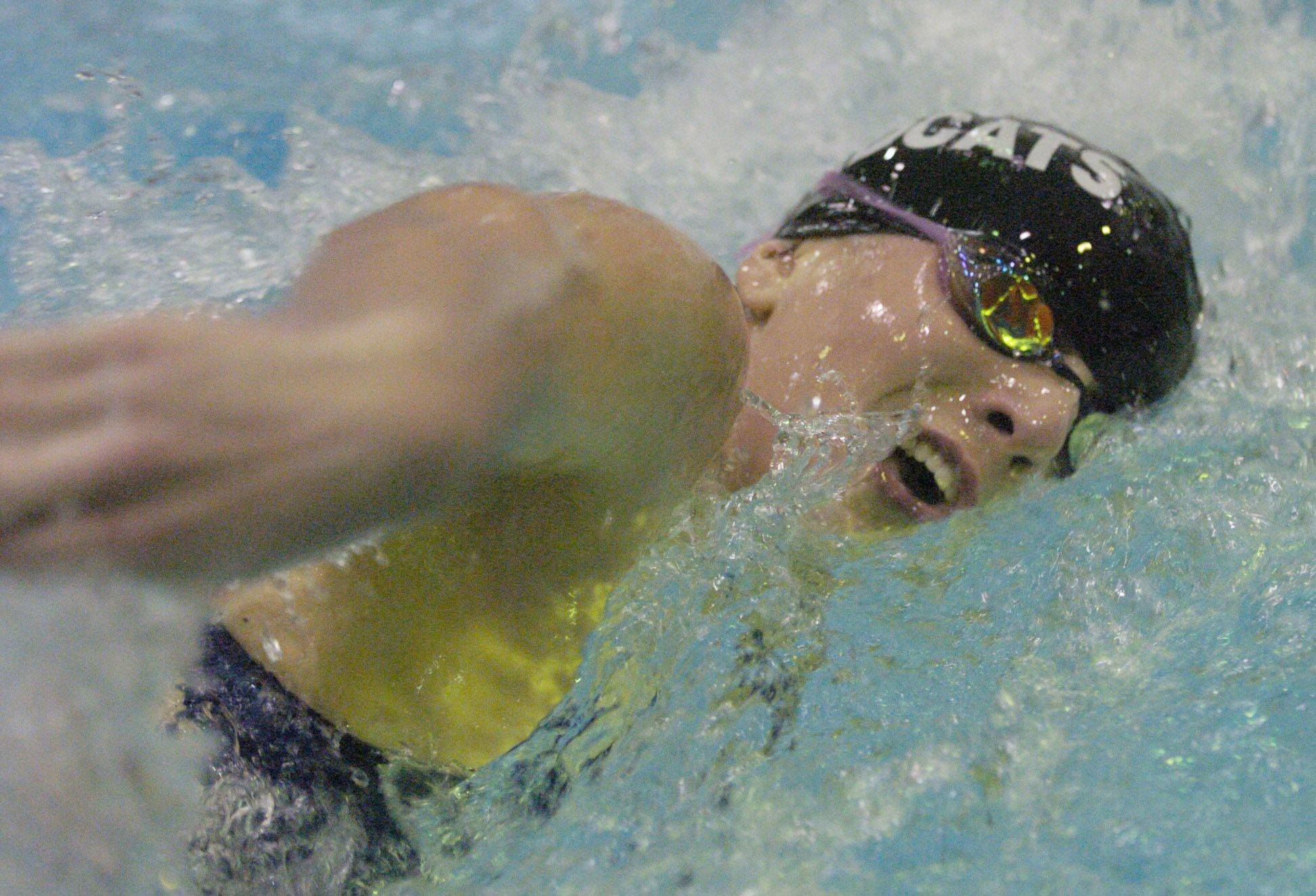 Kelly Dunn of West Chicago swims the 200-yard freestyle during Saturday's state swimming finals at Evanston.