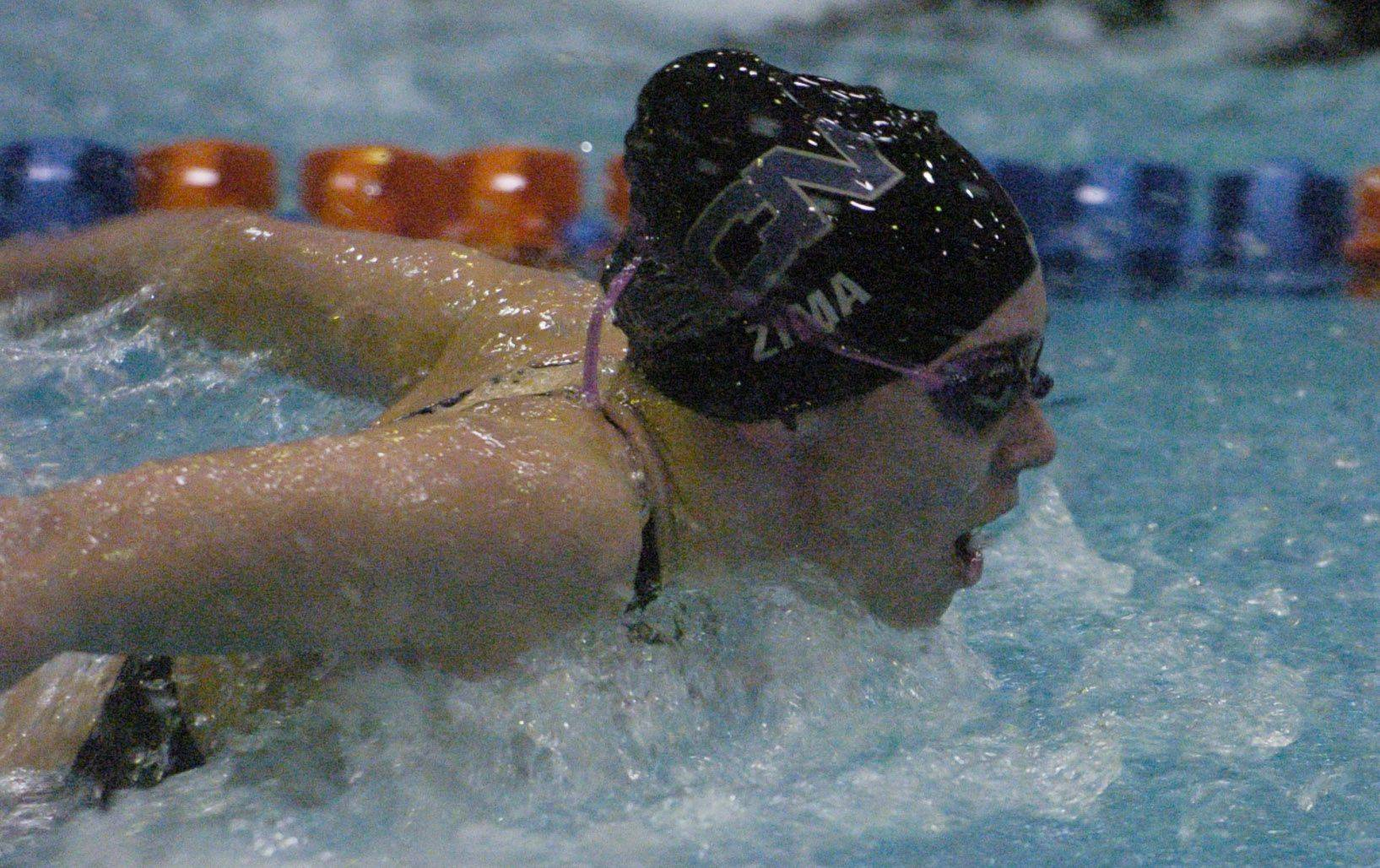 Lauren Zima of St. Charles North swims the 100-yard butterfly during Saturday's state swimming finals at Evanston.