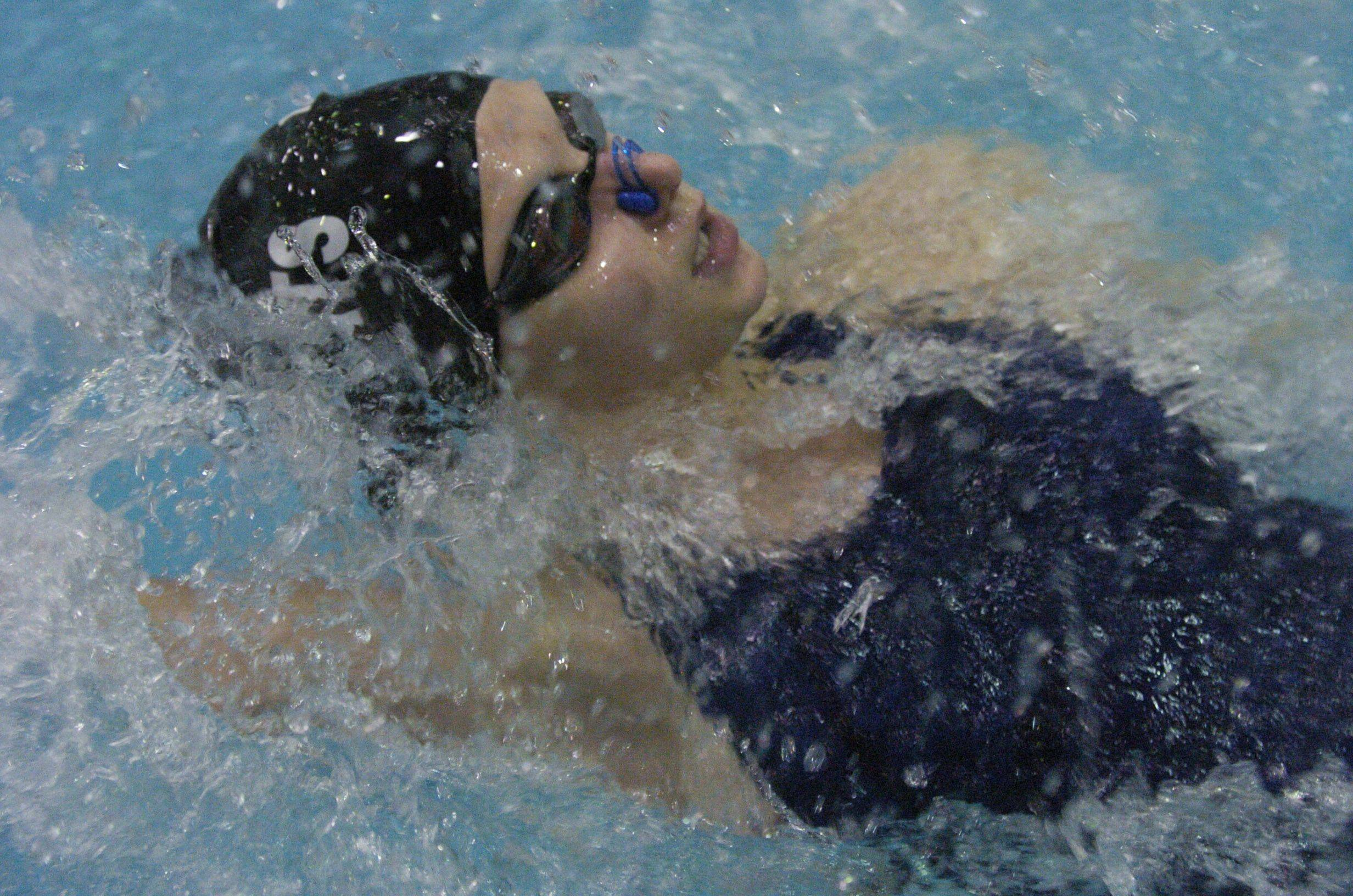 West Chicago's Maya Skorupski swims the 100-yard back stroke during Saturday's state swimming finals at Evanston.
