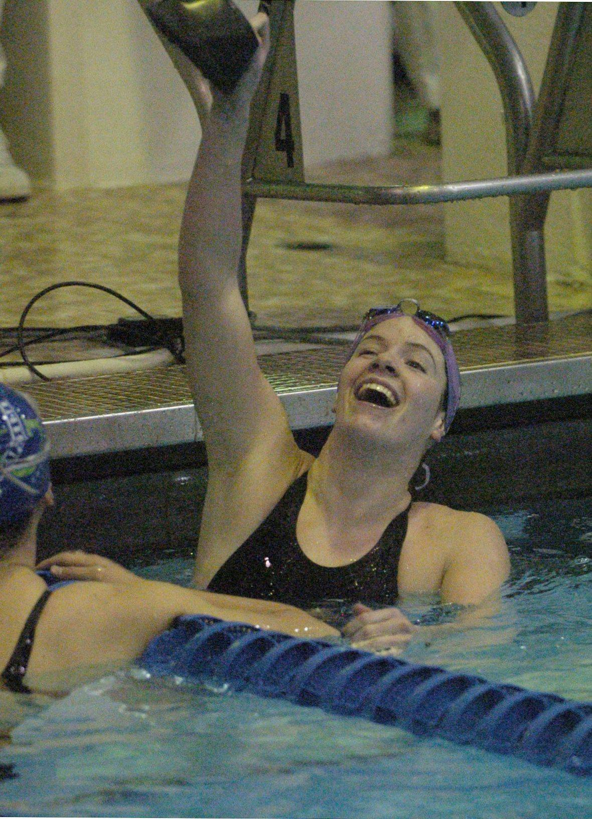 Haley Sims of Downers Grove North celebrates after winning the 200-yard individual medley during Saturday's state swimming finals at Evanston.