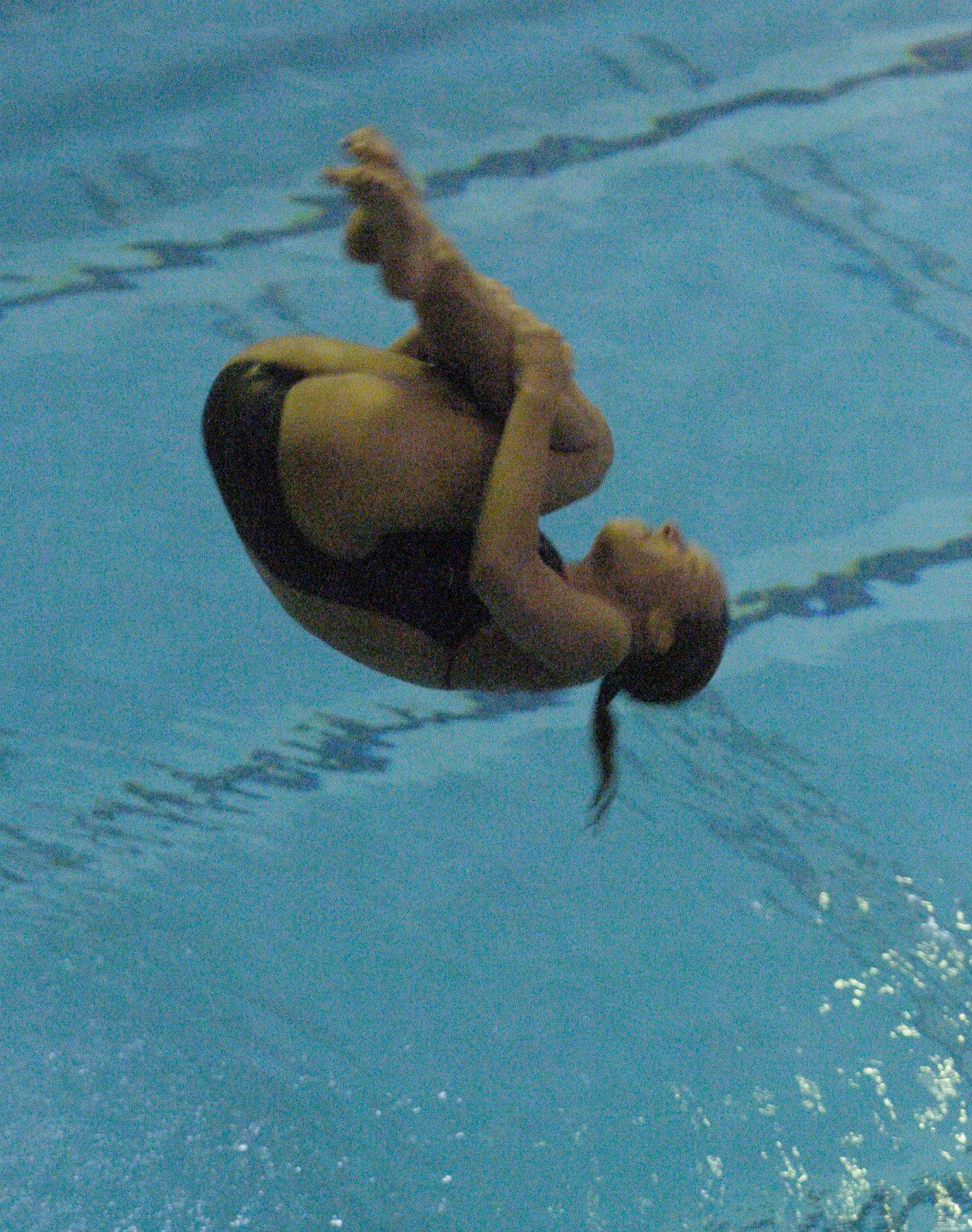Lauren Mikulecky of Neuqua Valley competes during Saturday's state diving finals at Evanston.