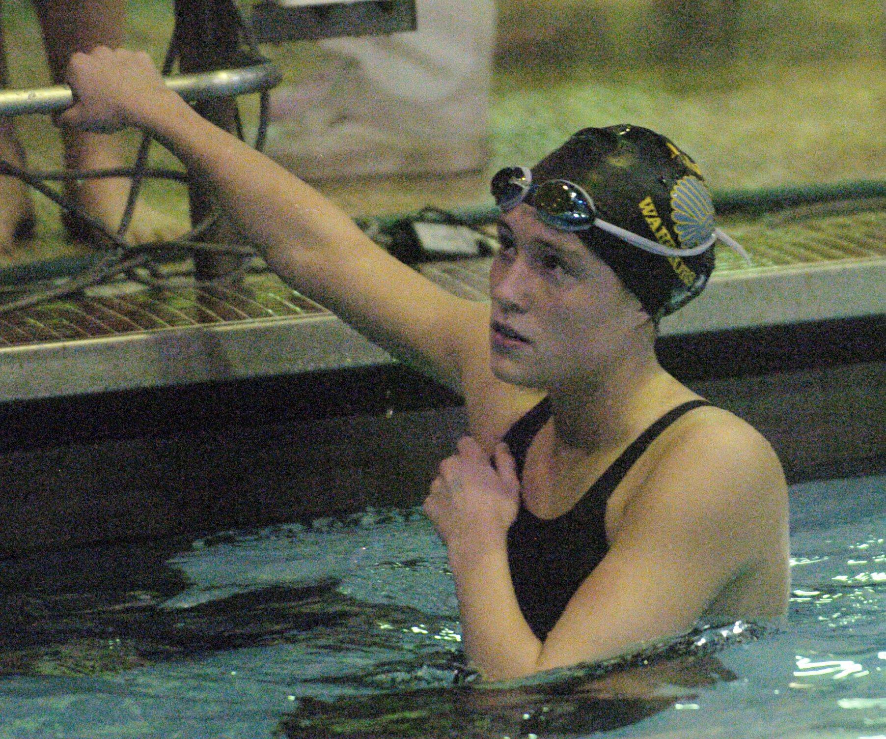 Ailish O'Connell of Maine West pauses after competing in the 50-yard freestyle during Saturday's state swimming finals at Evanston.