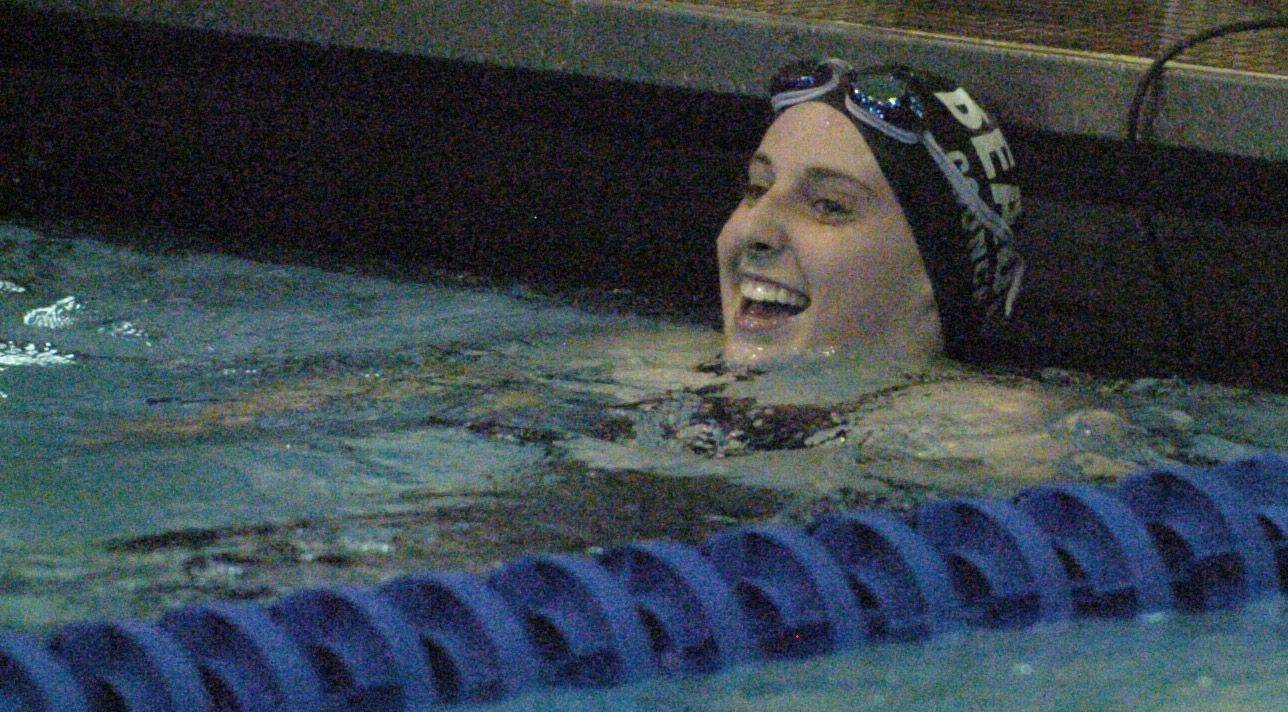Molly Coonce of Rosary reacts to her finish in the 100-yard breast stroke during Saturday's state swimming finals at Evanston.