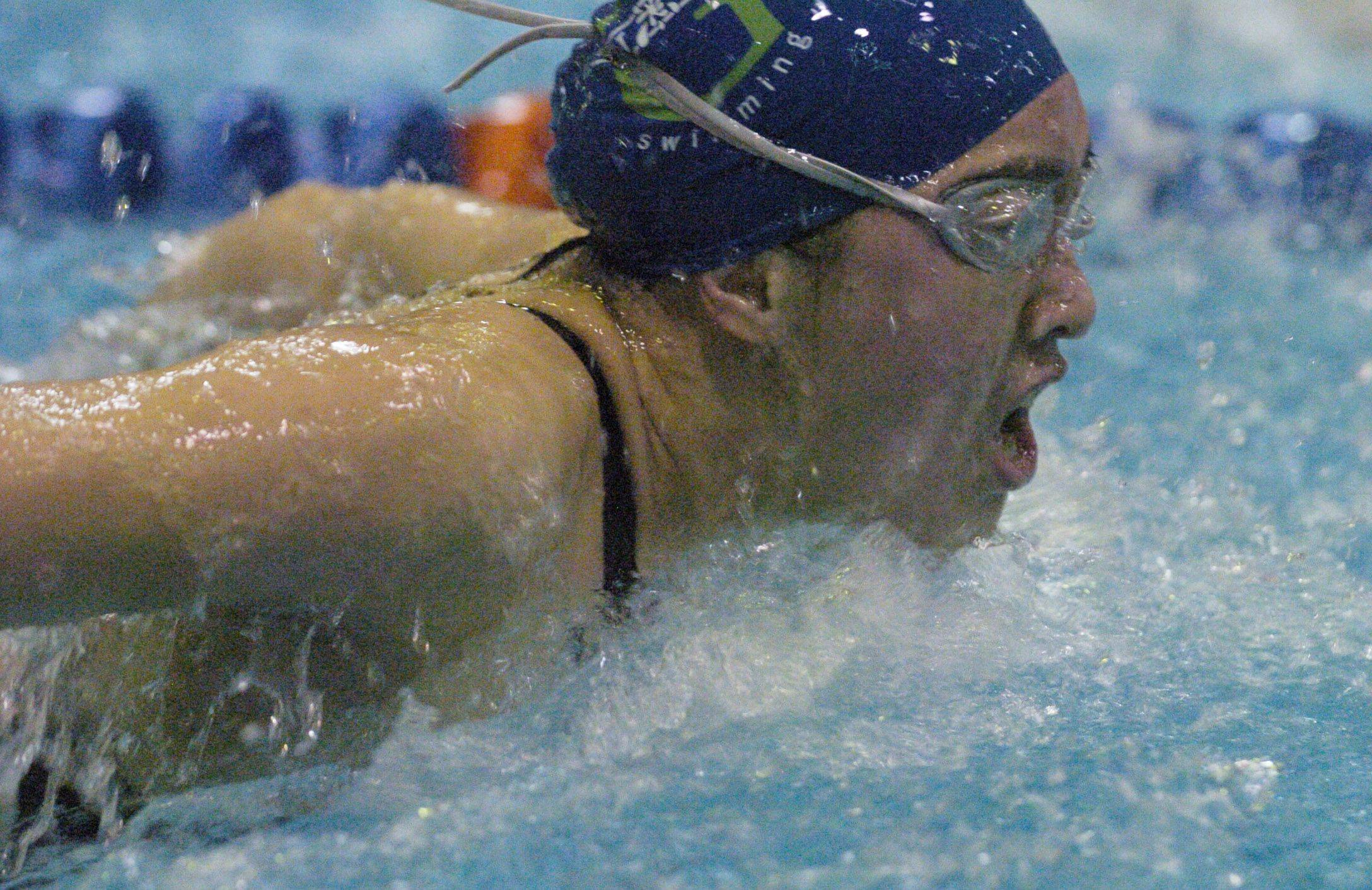 Connie Hsu of Glenbard West swims the 100-yard butterfly during Saturday's state swimming finals at Evanston.