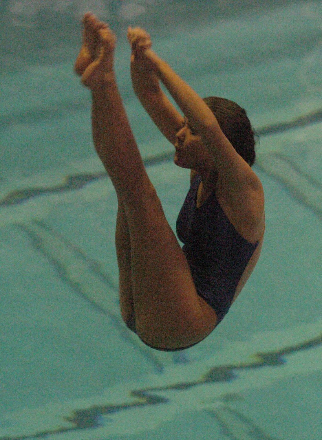 Jen Rey of Maine West competes during Saturday's state diving finals at Evanston.