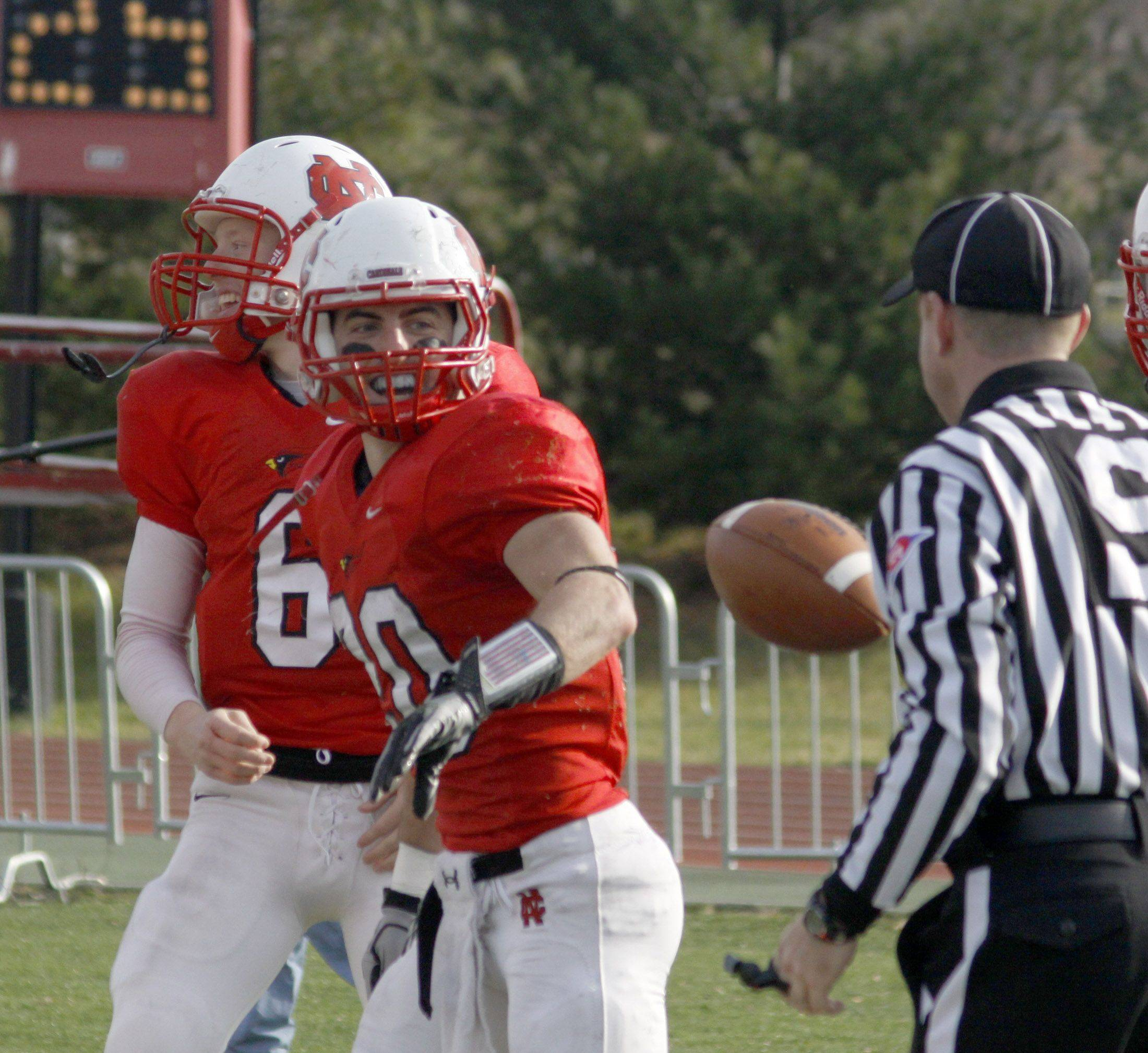 North Central College player, Joe Antonacci number 20, casually tosses the ball after bringing in a touchdown at Saturdays St. Norbert at North Central College playoff football game. North Central College went on to win 57 to 7.