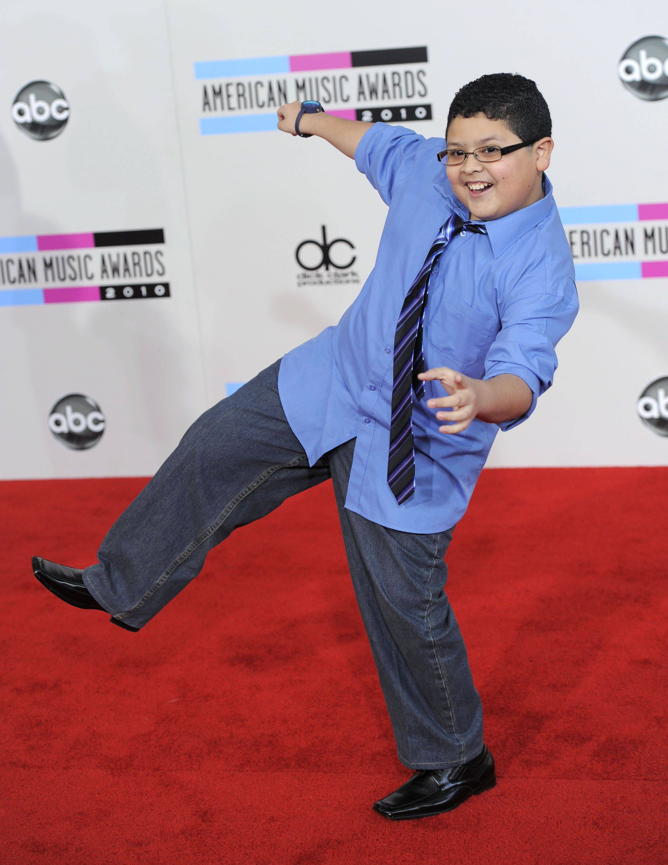 """Modern Family"" star Rico Rodriguez goof around on the red carpet before the show."