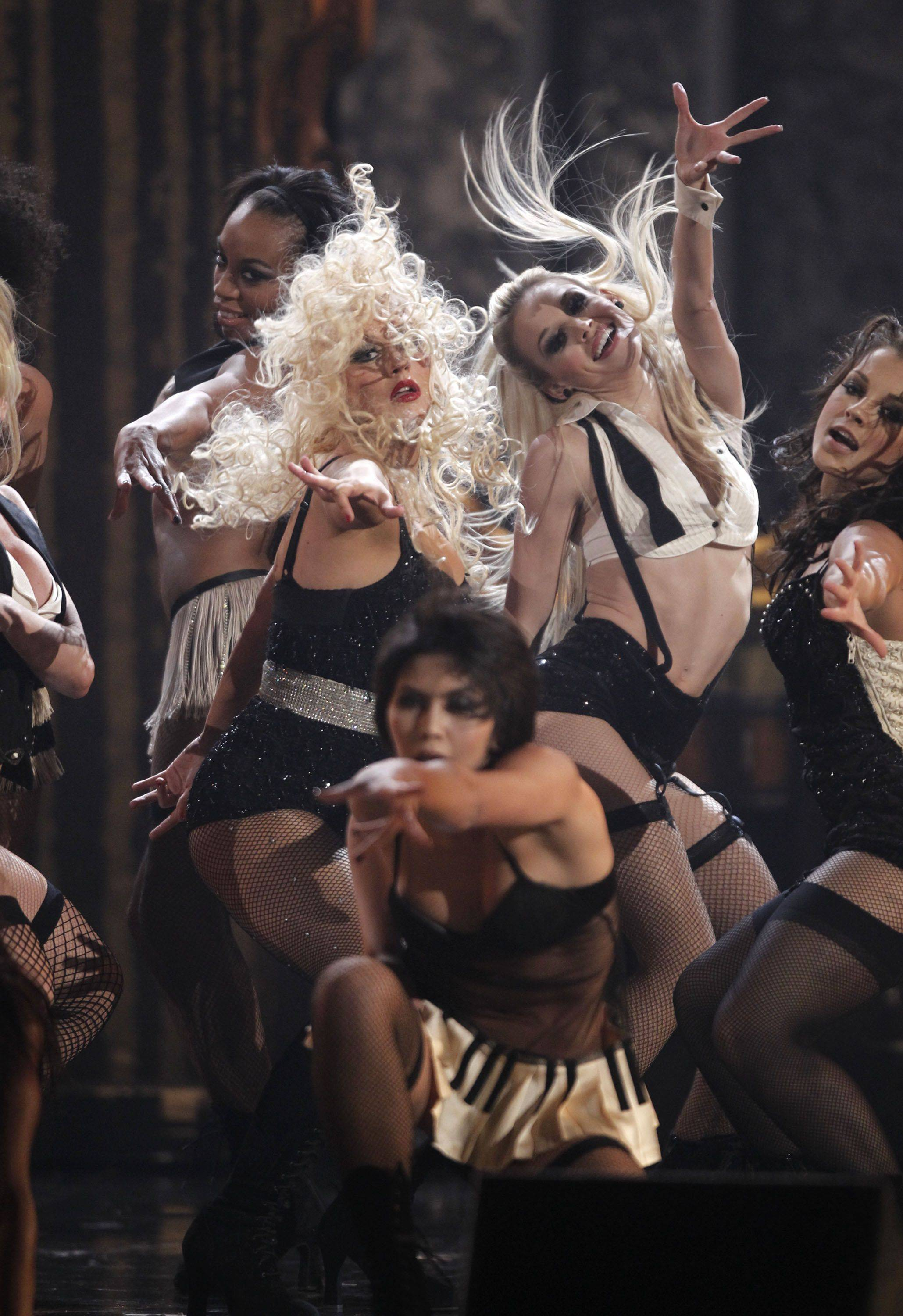 "Christina Aguilera, center left, and Kristen Bell, center left, co-stars in the upcoming ""Burlesque"" perform during the ceremony."