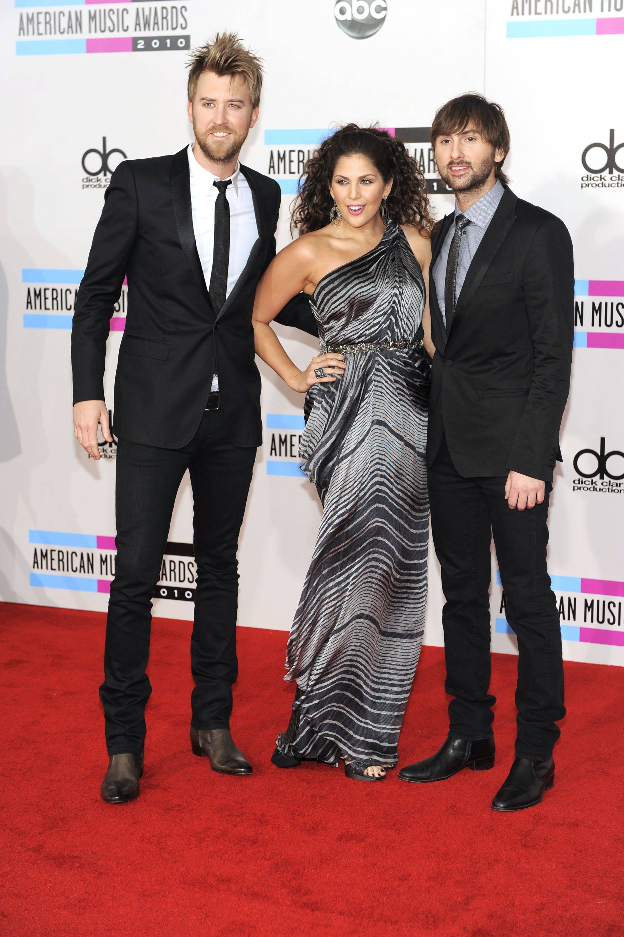 Lady Antebellum (from left, Charles Kelley, Hillary Scott and Dave Haywood) nominated for five awards walk the red carpet before the start of the show.