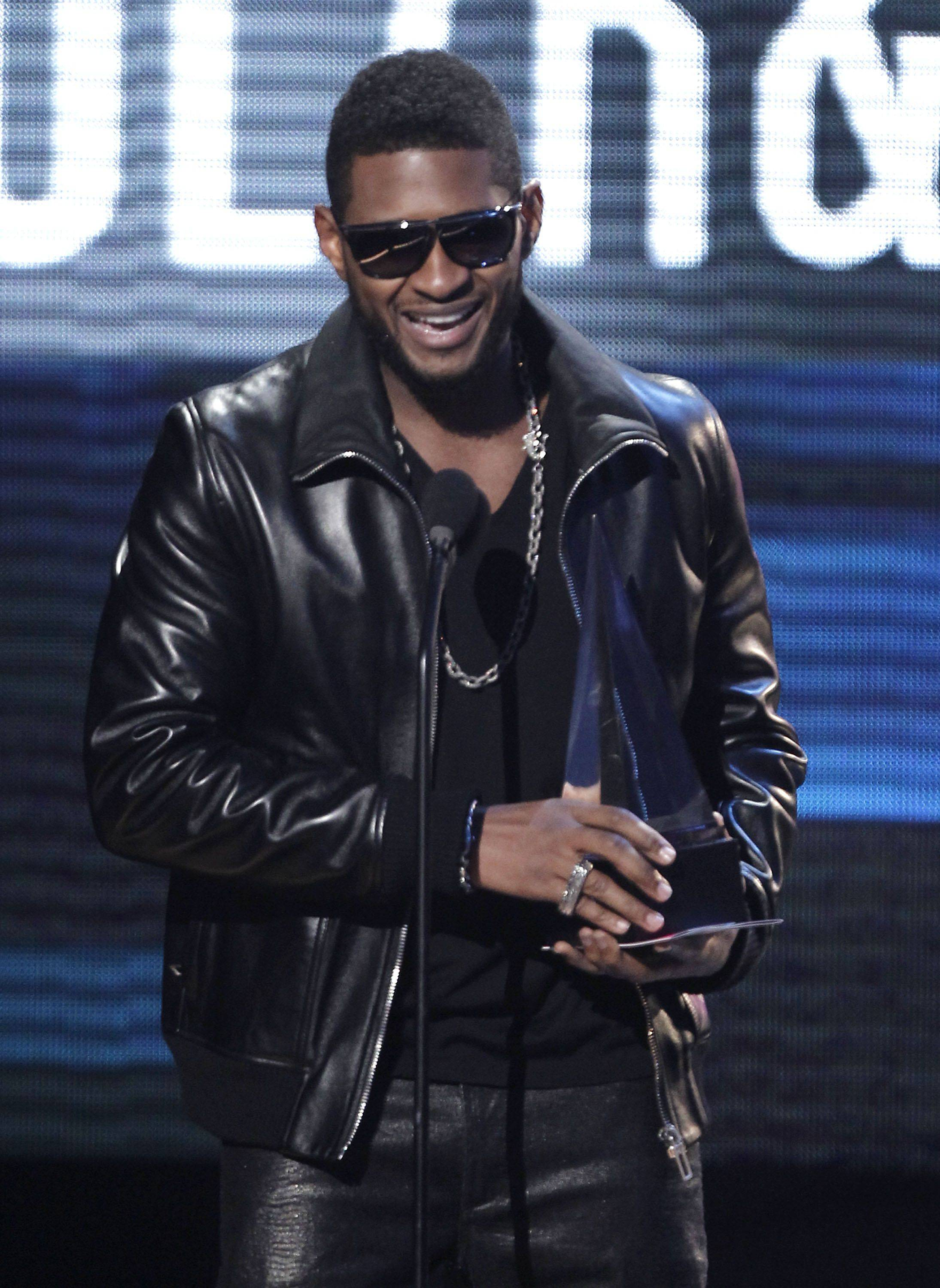 Usher, who would also perform, accepts the award for soul & R&B favorite album.