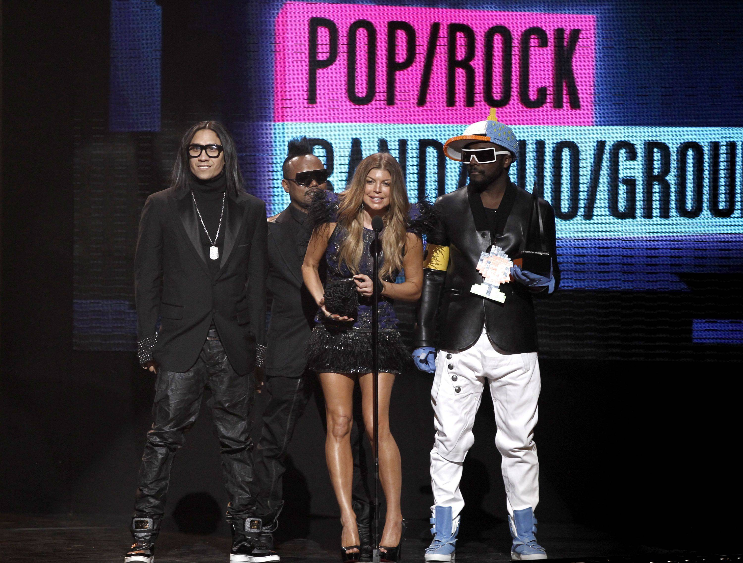 The Black Eyed Peas accept the favorite band, duo or group award at the 38th Annual American Music Awards. From left are, Taboo, Apl.de.ap, Fergie and Will.i.am.