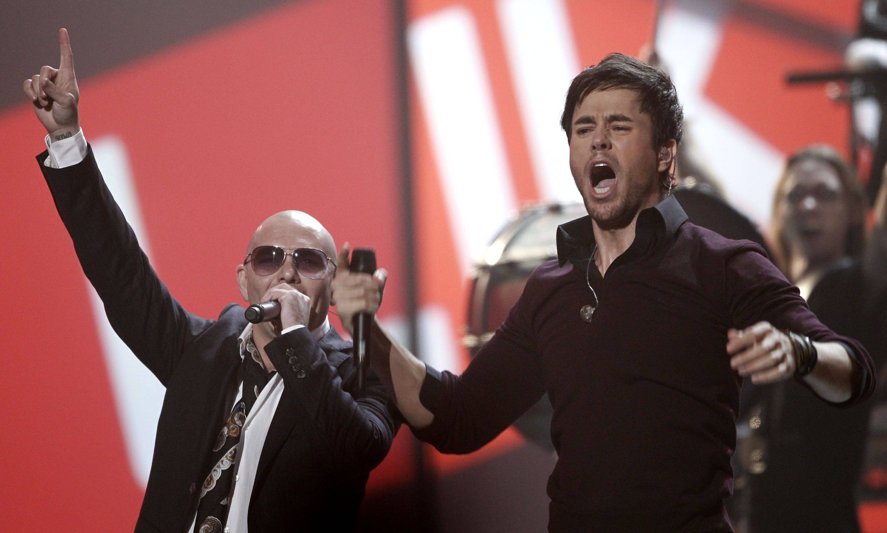 Pitbull, left, and Enrique Iglesias perform.
