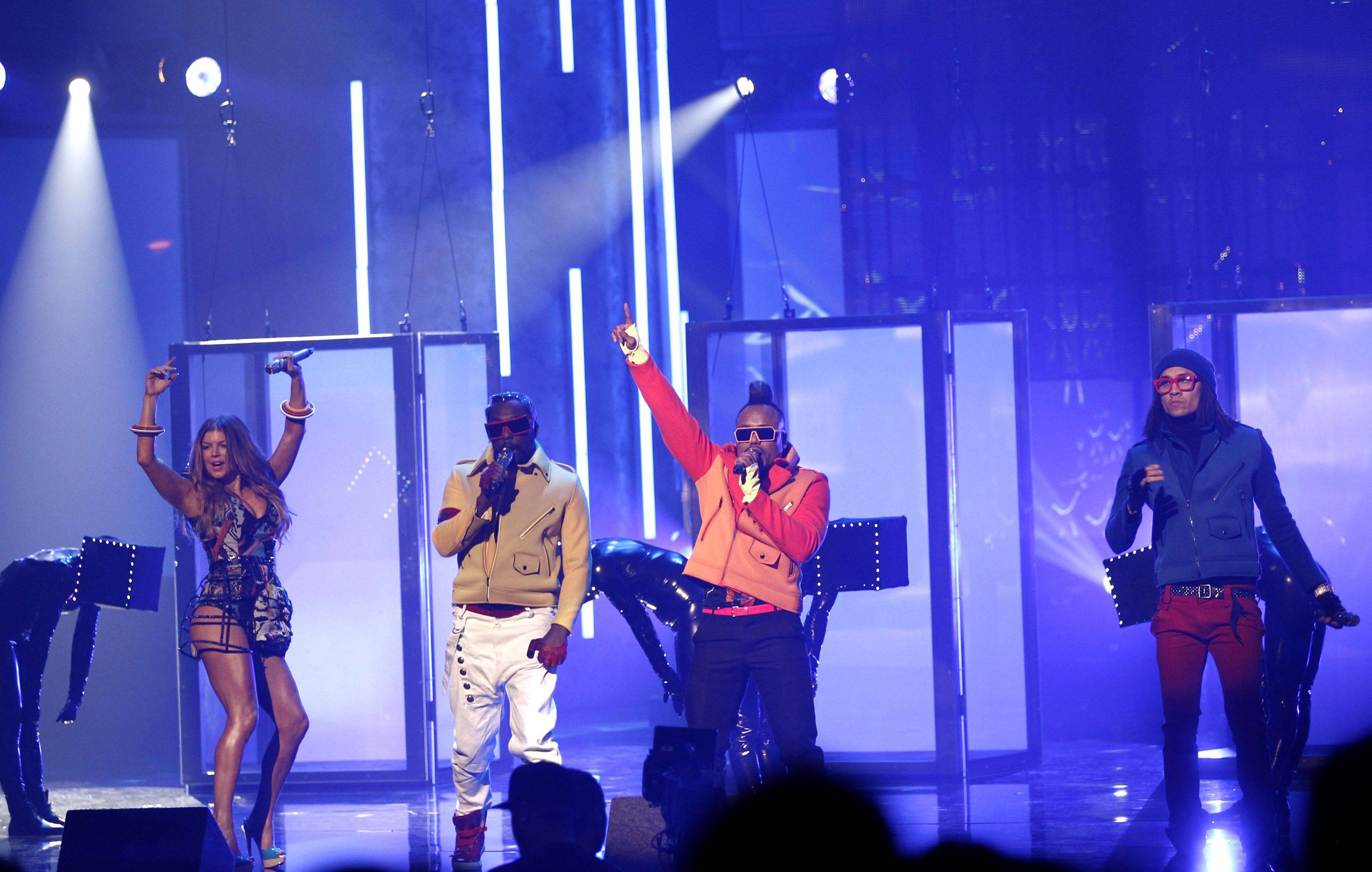 The Black Eyed Peas perform at the 38th Annual American Music Awards on Sunday, Nov. 21, 2010 in Los Angeles. From left are, Fergie, Will.i.am, Apl.de.ap, and Taboo.