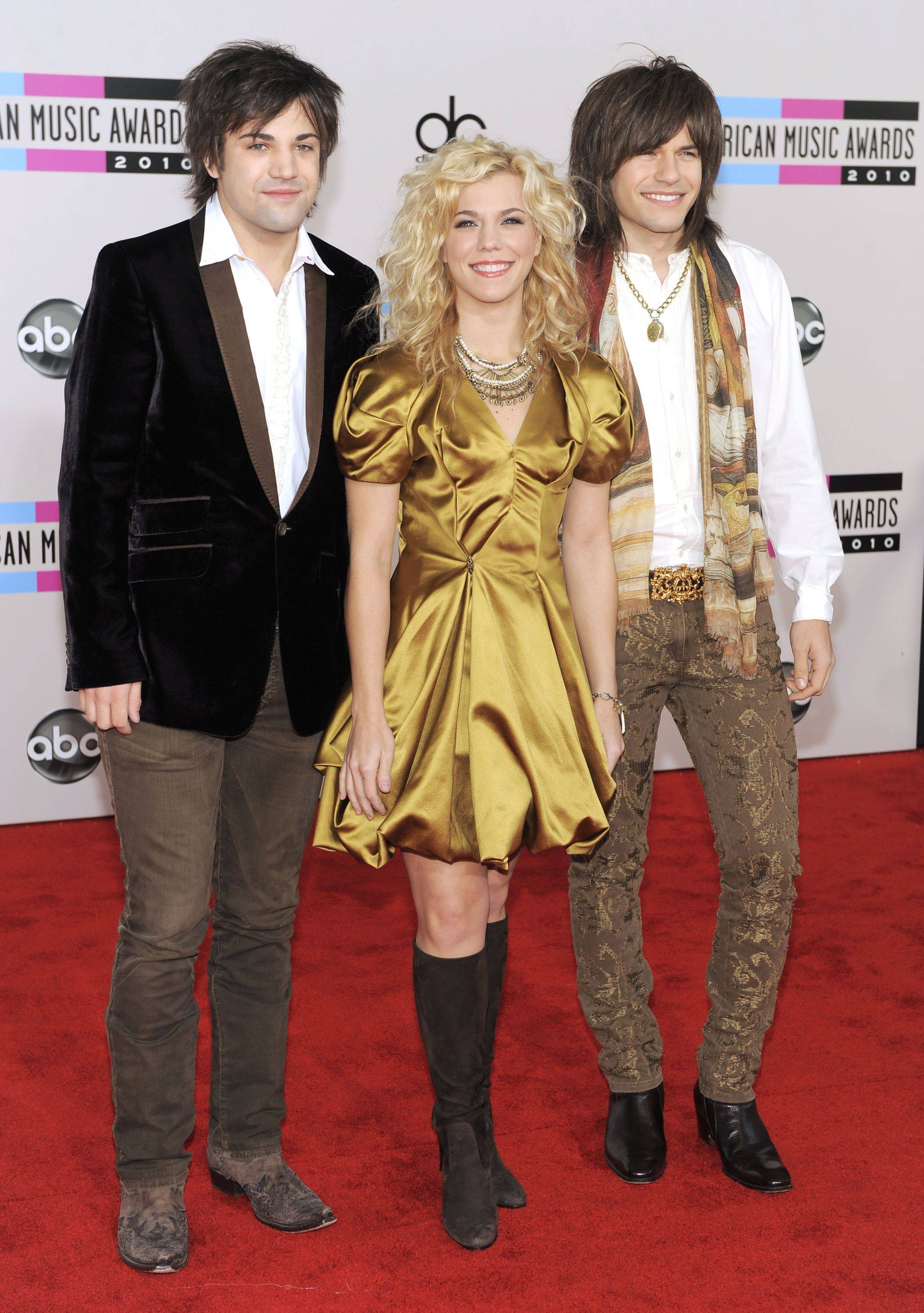 The Band Perry, from left, Neil Perry, Kimberly Perry, and Reid Perry arrive at the 38th Annual American Music Awards. The band would later present an award.