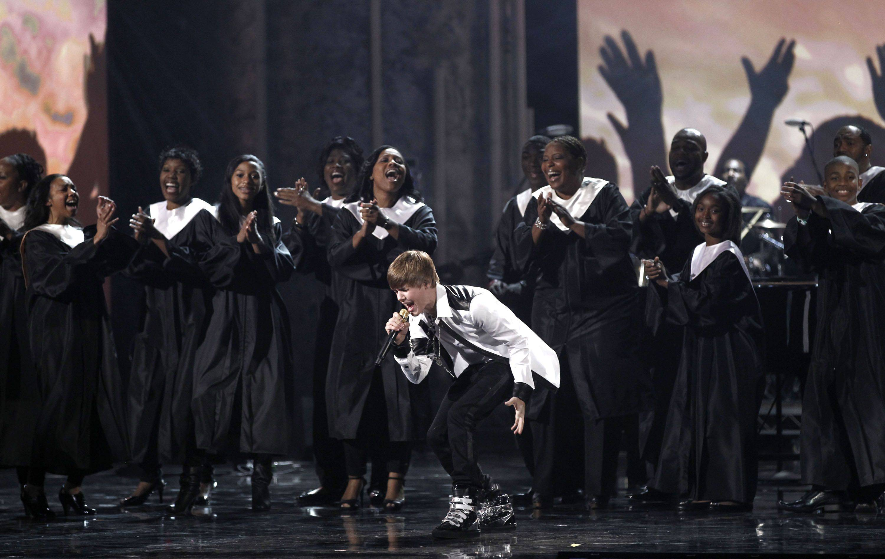 Justin Bieber performs with a choir at the 38th Annual American Music Awards on Sunday. Bieber would go on to have a big night, winning four trophies, more than any other artist.
