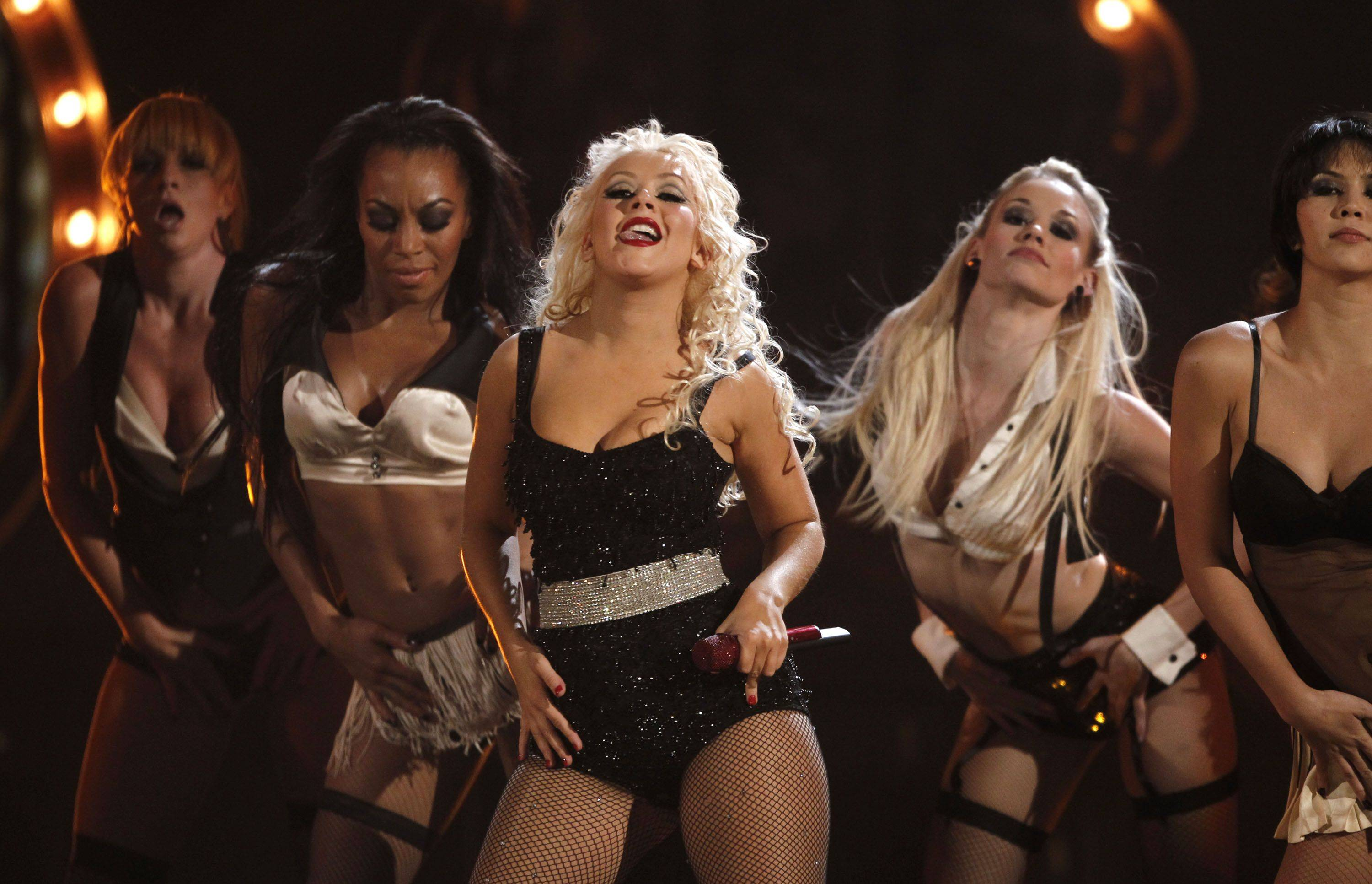 "Christina Aguilera, left, and Kristen Bell perform a song from ""Burlesque."""
