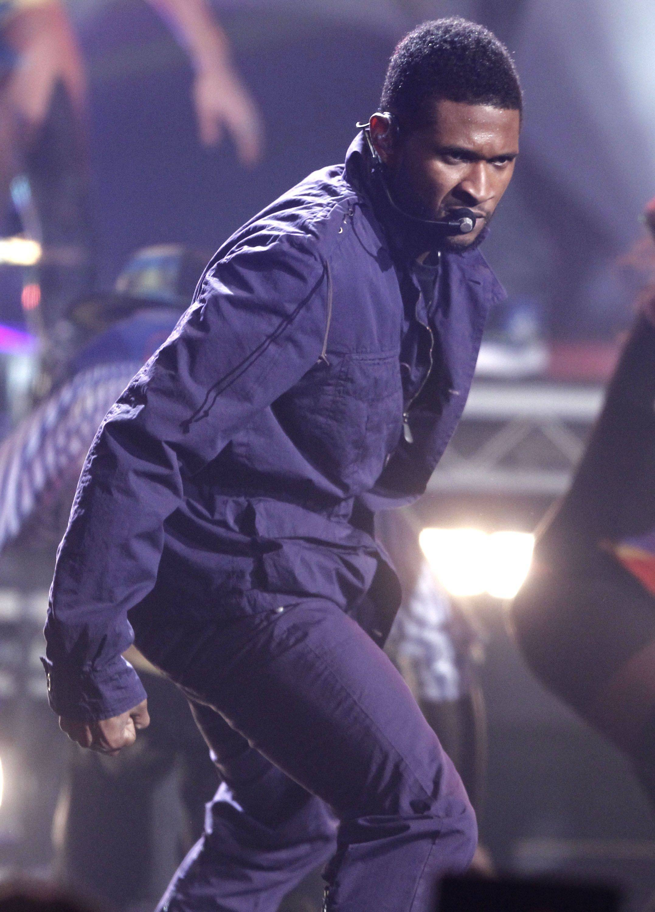 Usher performs at the 38th Annual American Music Awards on Sunday, Nov. 21, 2010 in Los Angeles.
