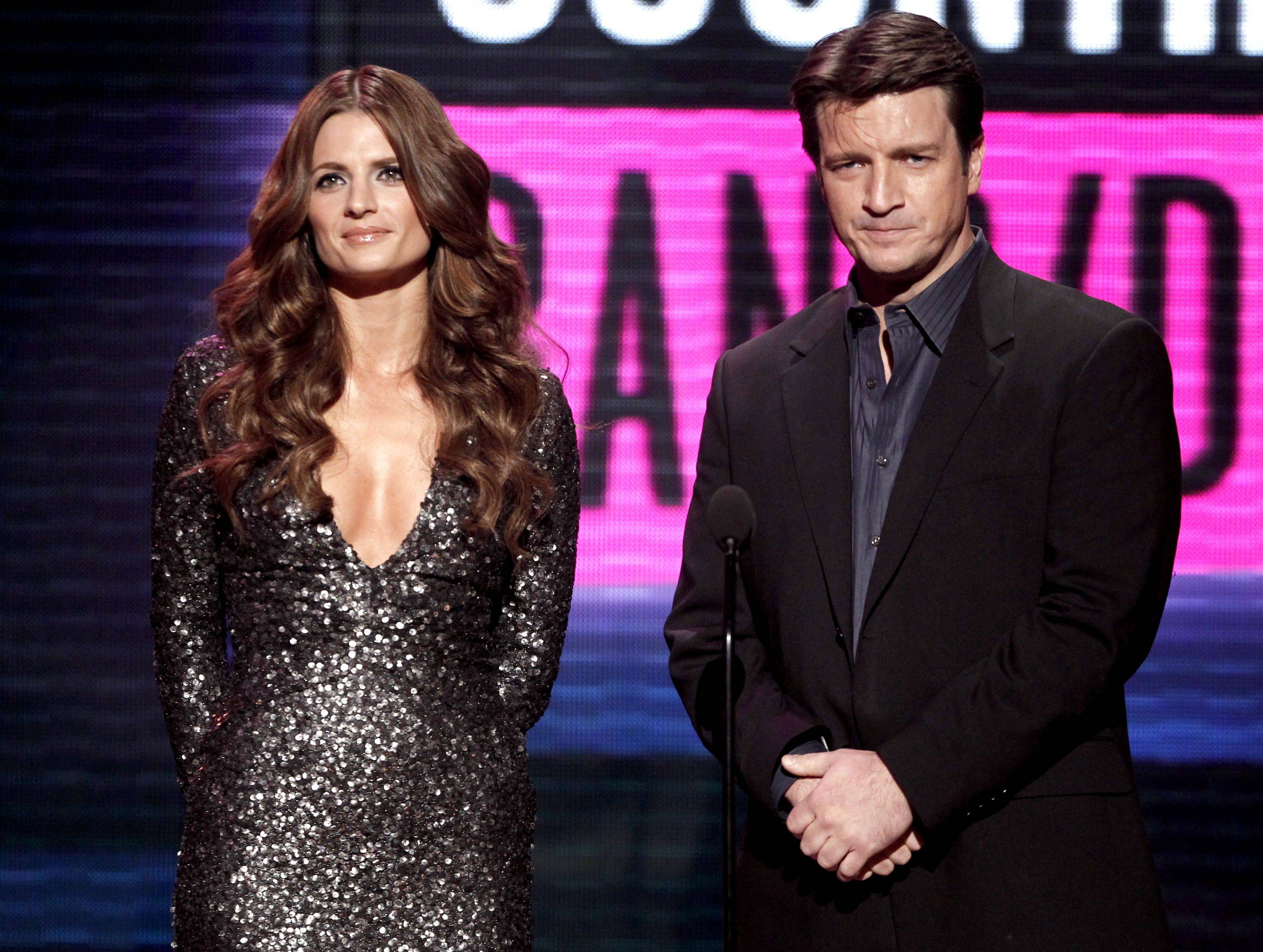 """Castle"" co-stars Stana Katic, left, and Nathan Fillion are seen on stage at the 38th Annual American Music Awards."