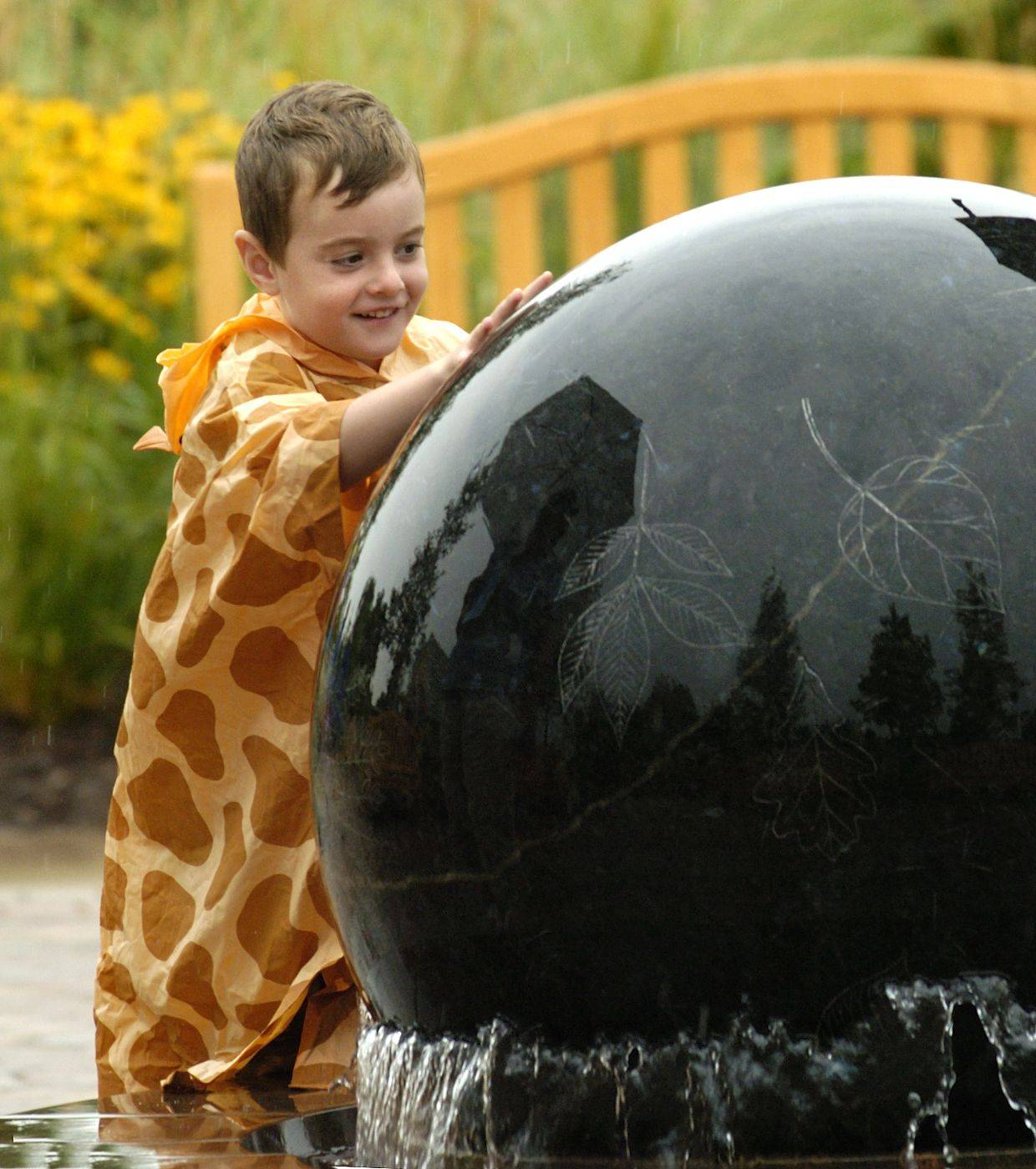 Justin Ligeski of Plainfield was just 4 years old when the Morton Arboretum's Children's Garden opened in August 2005. More than 1.8 million people have visited the garden since its opening.