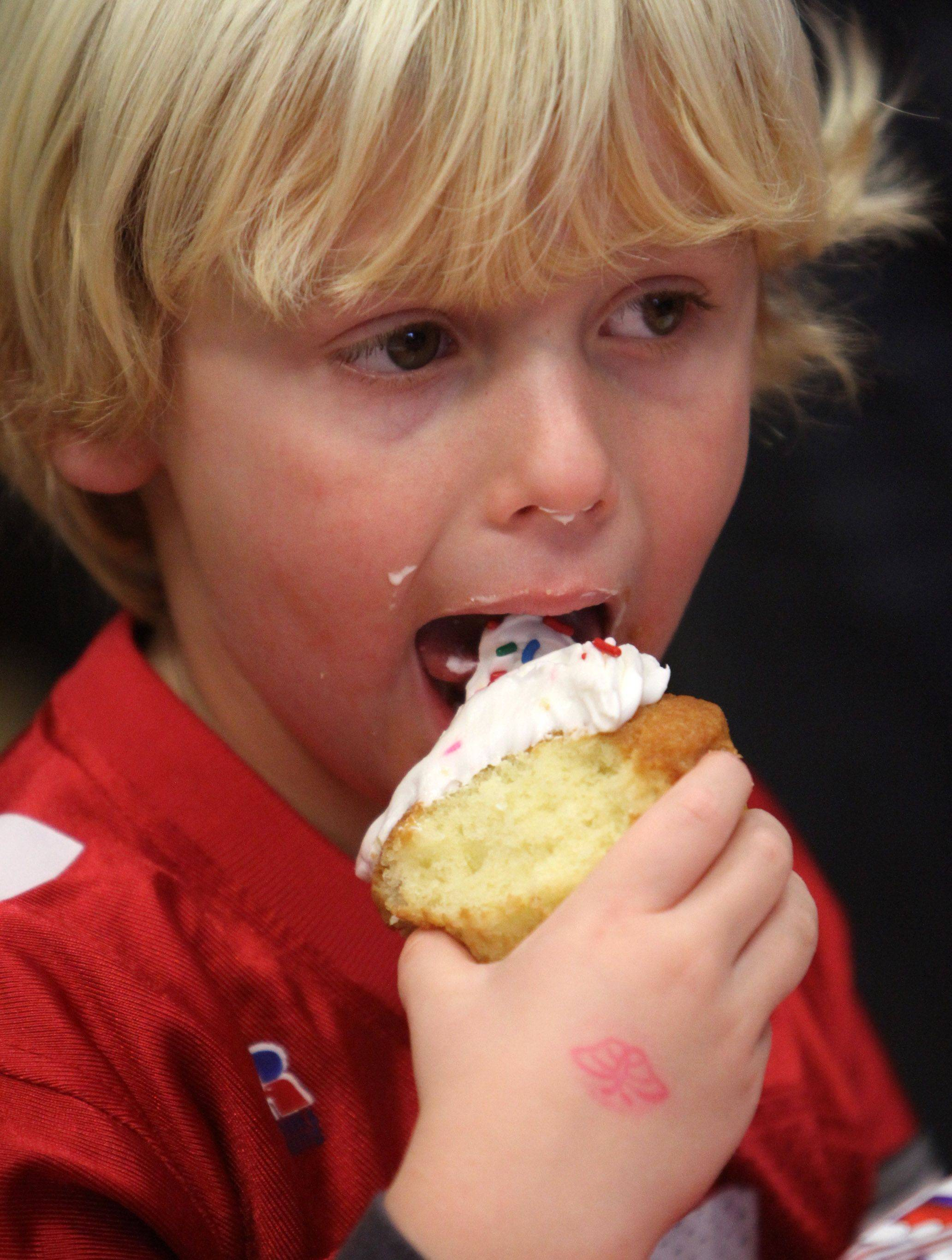 Three-year-old Jack Hieronymus of Grayslake enjoys a cupcake at a fundraiser for Bridget Kennicott of Carpentersville. Kennicott is battling a rare disorder known as Batten disease. The event was held at Kohl's Children's Museum in Glenview on Saturday, November 13. Bridget's mother, Sara Kennicott, is a Barrington school teacher.
