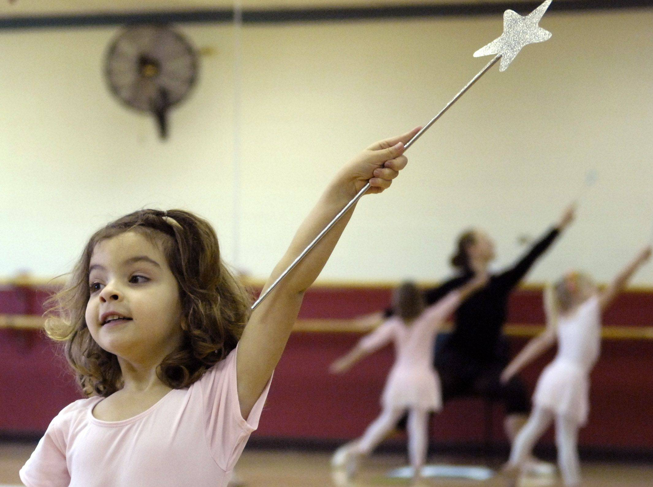 "Danielle Gregory, 4, of Geneva follows the lead of teacher Katie Behrens during a pre-ballet class for girls aged 3-5 at Sunset Racquetball and Fitness Center in Geneva Monday. The girls in this class will be snowflakes in the Geneva Park District Sunset Dancers production of ""The Nutcracker"" at Geneva High School Dec. 19."