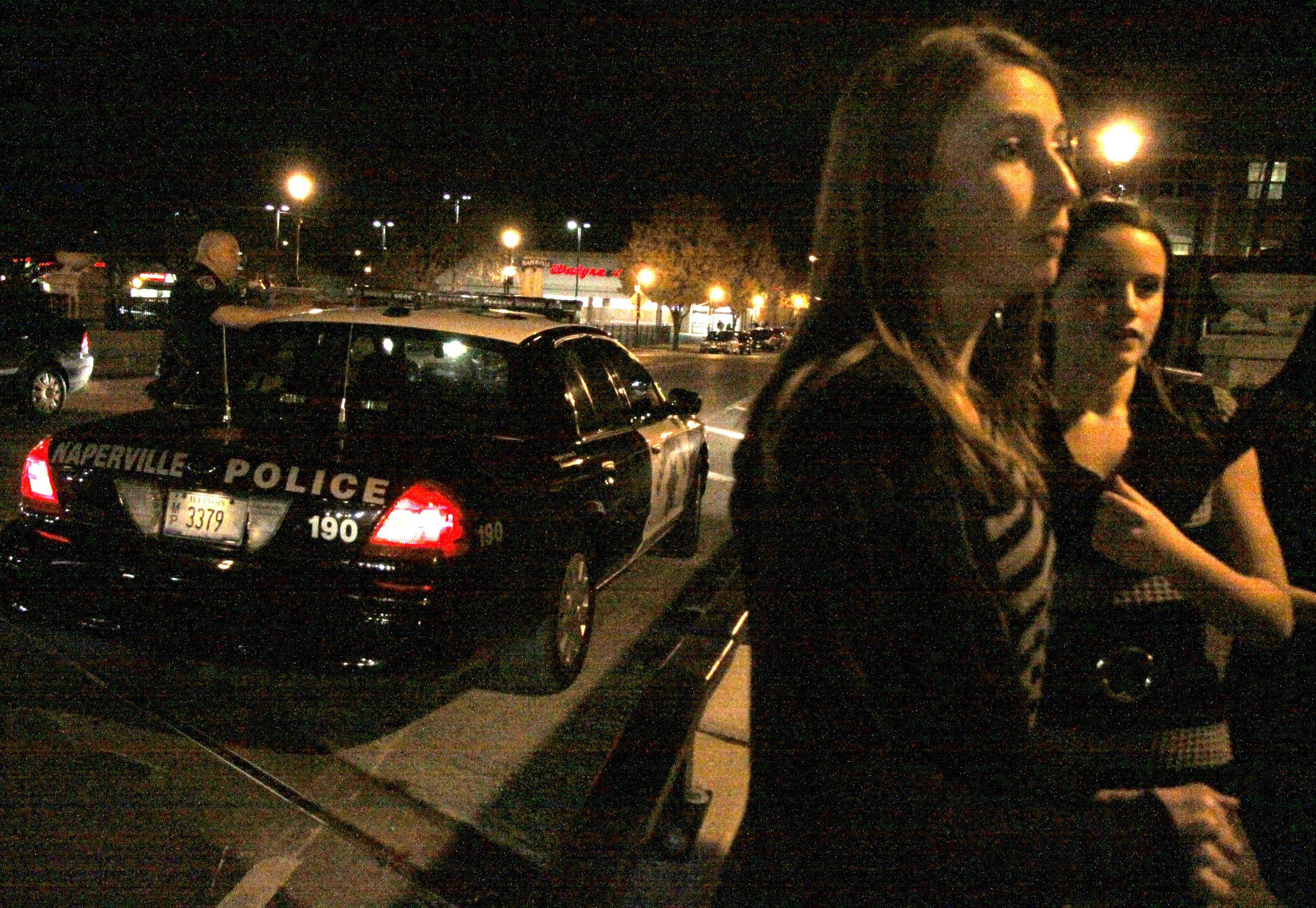 A group of young girls stopped to ask a Naperville police officer what the curfew was for underaged kids in Naperville Friday night.