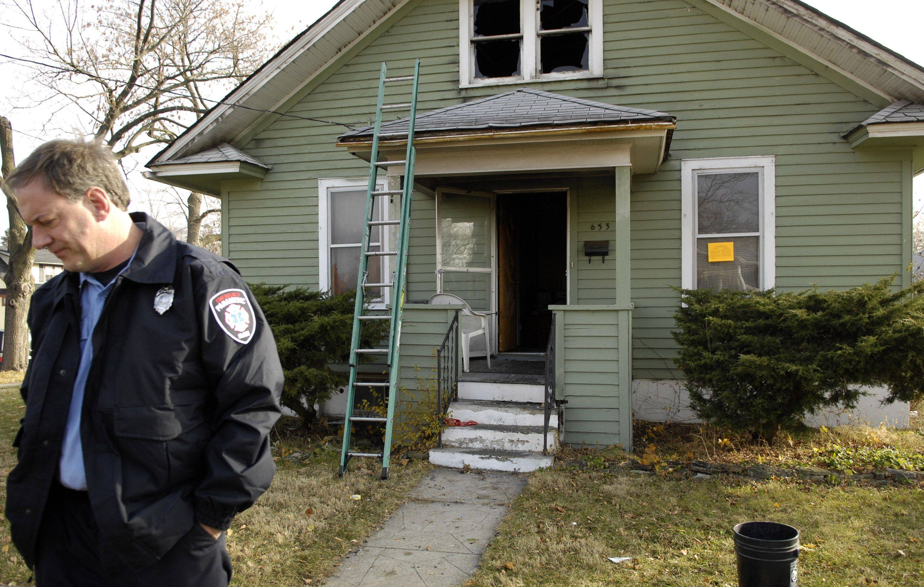 Elgin Fire Lt. Robert Bedard leaves after stopping by to check out the scene of a house fire that claimed the life of an elderly woman at 653 Prospect Street in Elgin overnight.