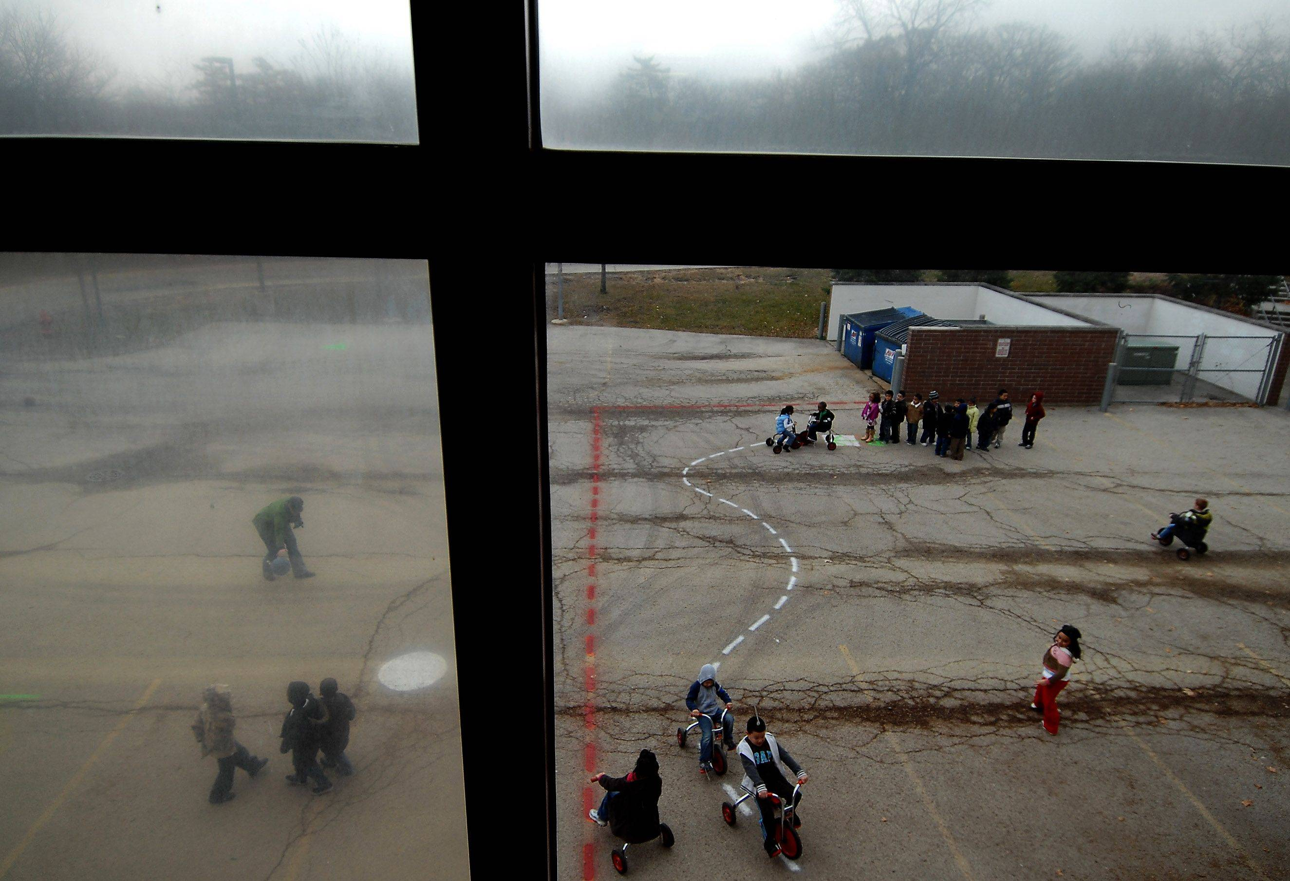Kindergartners at Illinois Park School in Elgin play on the loading dock Wednesday. The school is thought to be the one of few, if not the only one in Illinois without a playground.