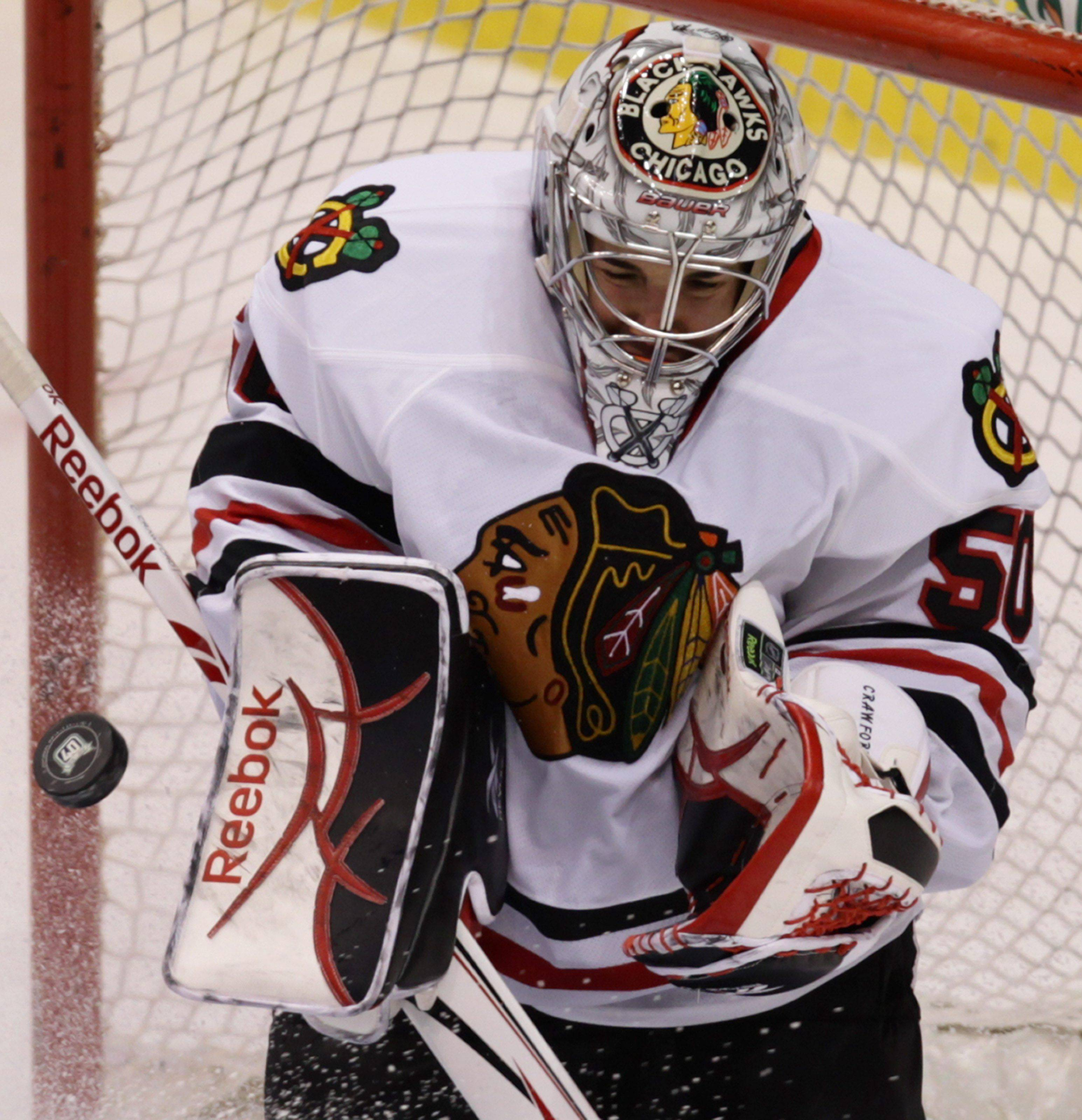 Corey Crawford makes a save in Saturday's 7-1 Blackhawks victory at Vancouver.